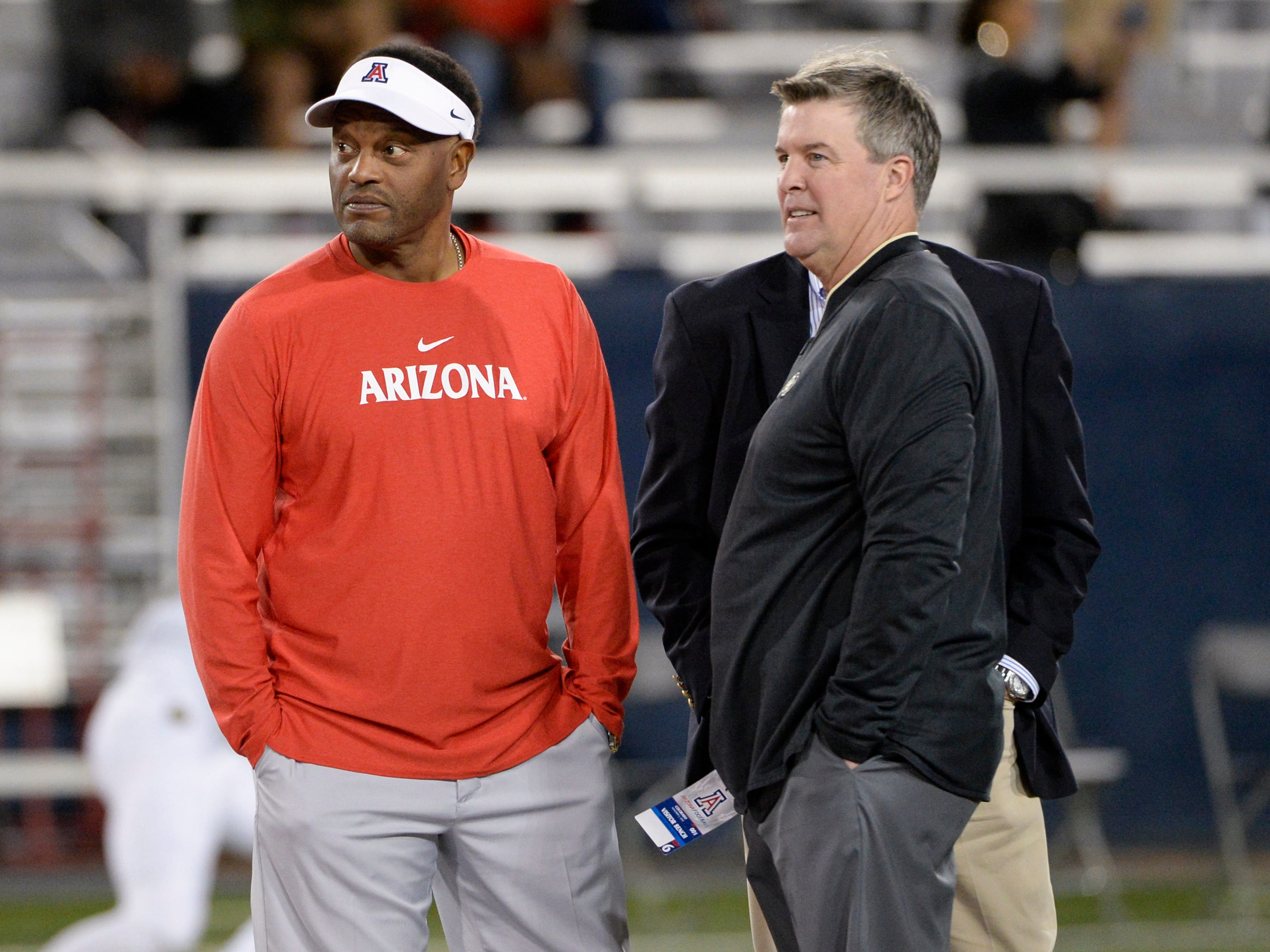 Nov 2, 2018; Tucson, AZ, USA; Arizona Wildcats head coach Kevin Sumlin (left) and Colorado Buffaloes head coach Mike MacIntyre (right) talk before a game at Arizona Stadium.
