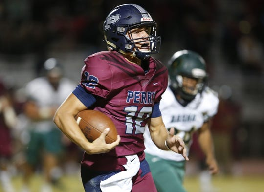 Perry quarterback Chubba Purdy (12) carries the ball during a football game against Basha at Perry High School on Nov. 2. #azhsfb