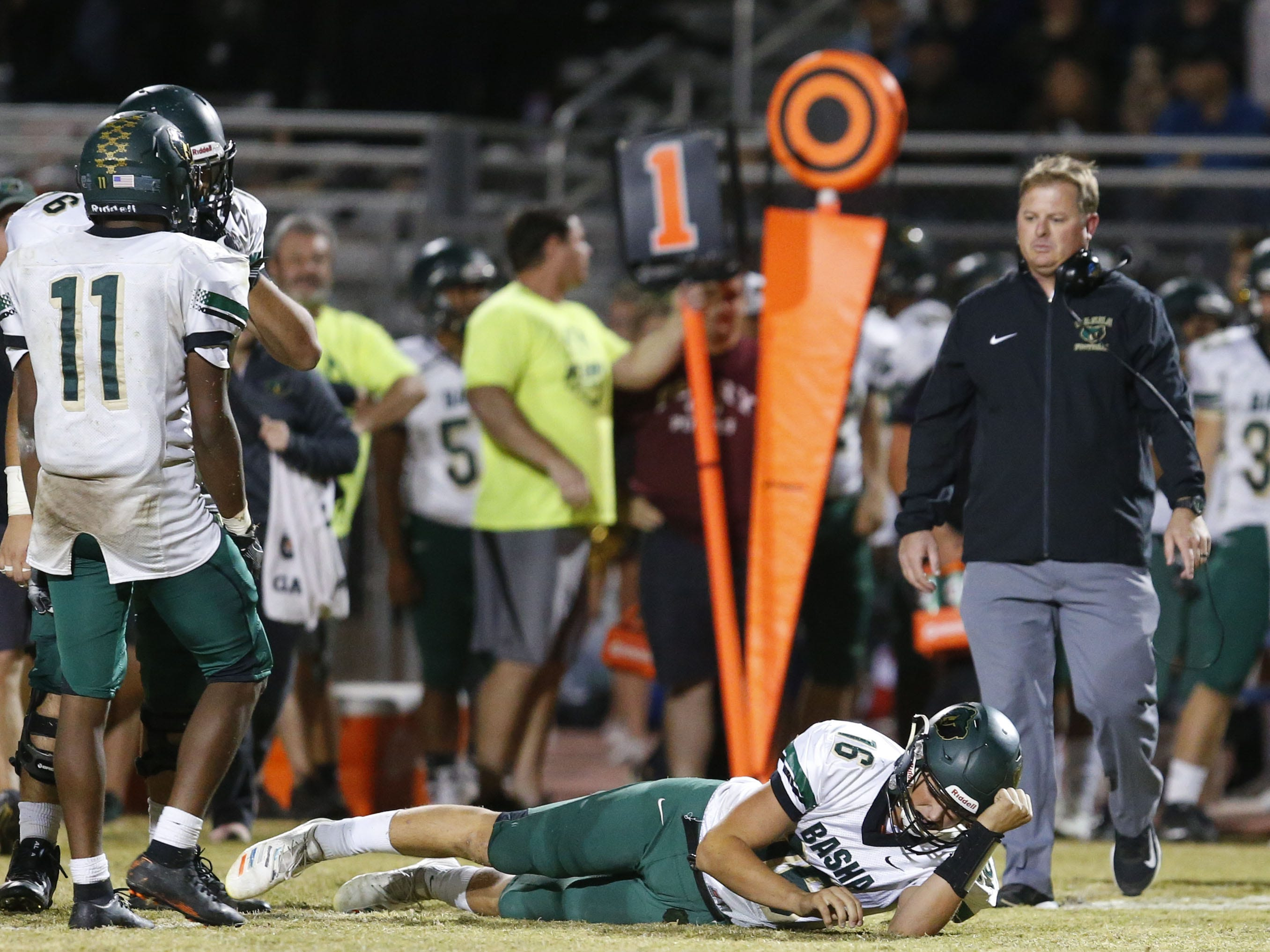 Bashas head coach Chris McDonald walks onto the field after quarterback Gabe Friend (16) is injured during the fourth quarter of a football game against Perry at Perry High School on November 2. #azhsfb
