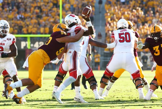 Arizona State defensive lineman Jermayne Lole forces a fumble by Utah quarterback Jason Shelley in the second half on Nov. 3 at Sun Devil Stadium.