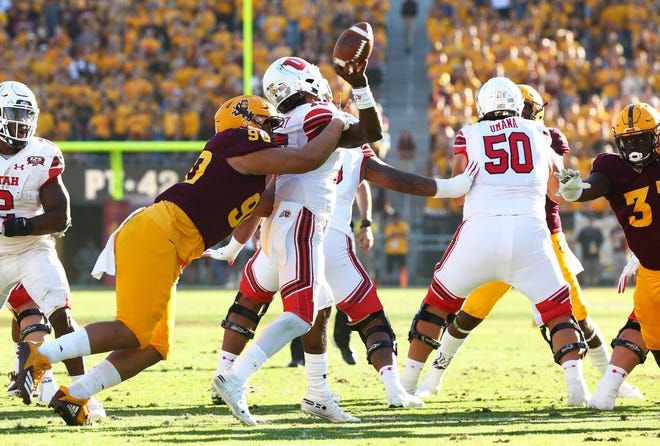 Arizona State defensive lineman Jermayne Lole forces a fumble by Utah quarterback Jason Shelley in the second half on Nov. 3 at Sun Devil Stadium.