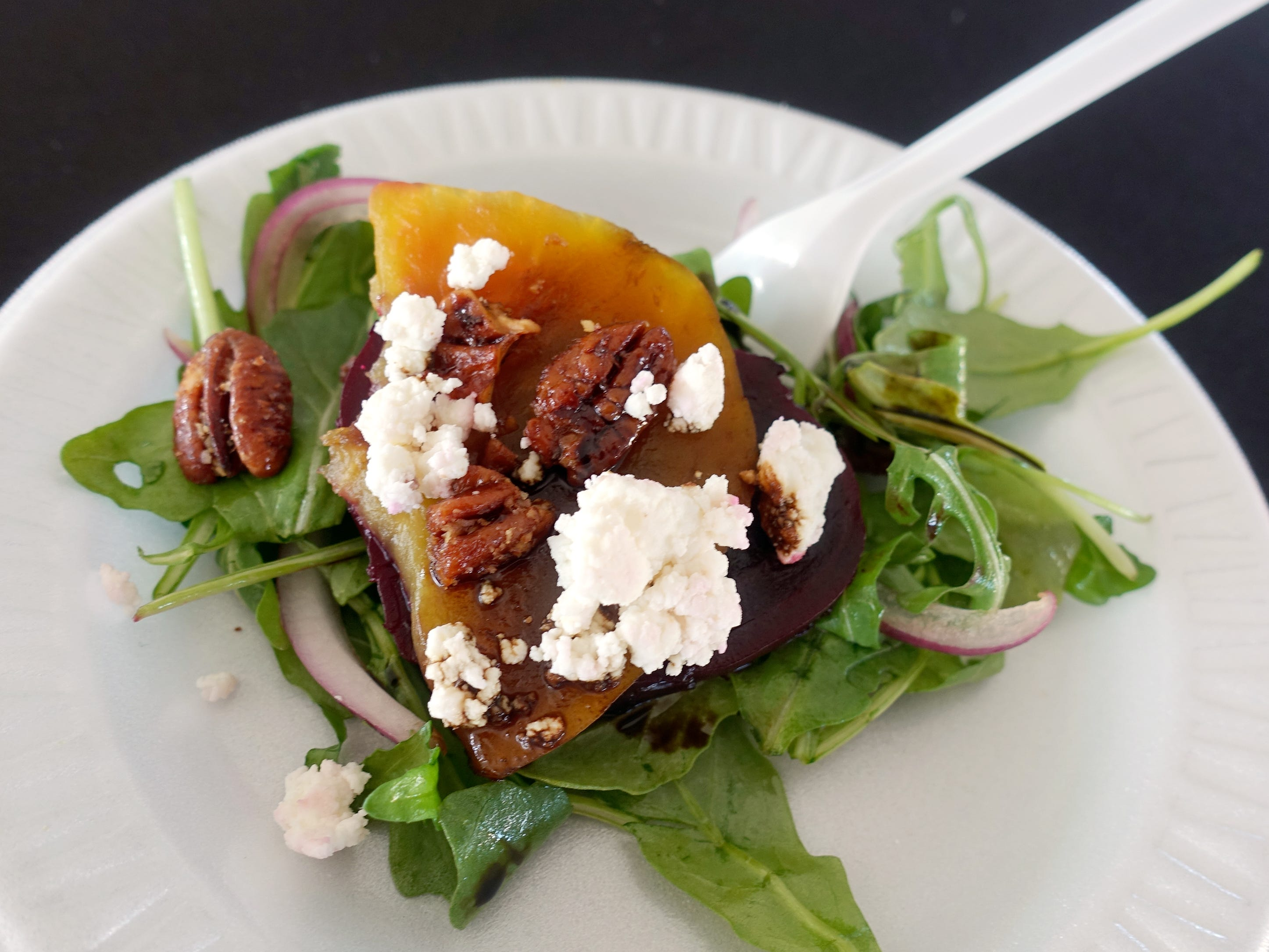 Organic beet salad with arugula, red onion, goat cheese, candied pecans and balsamic reduction from Timo Wine Bar at azcentral Wine & Food Experience 2018 at WestWorld of Scottsdale, Saturday, Nov. 3, 2018.