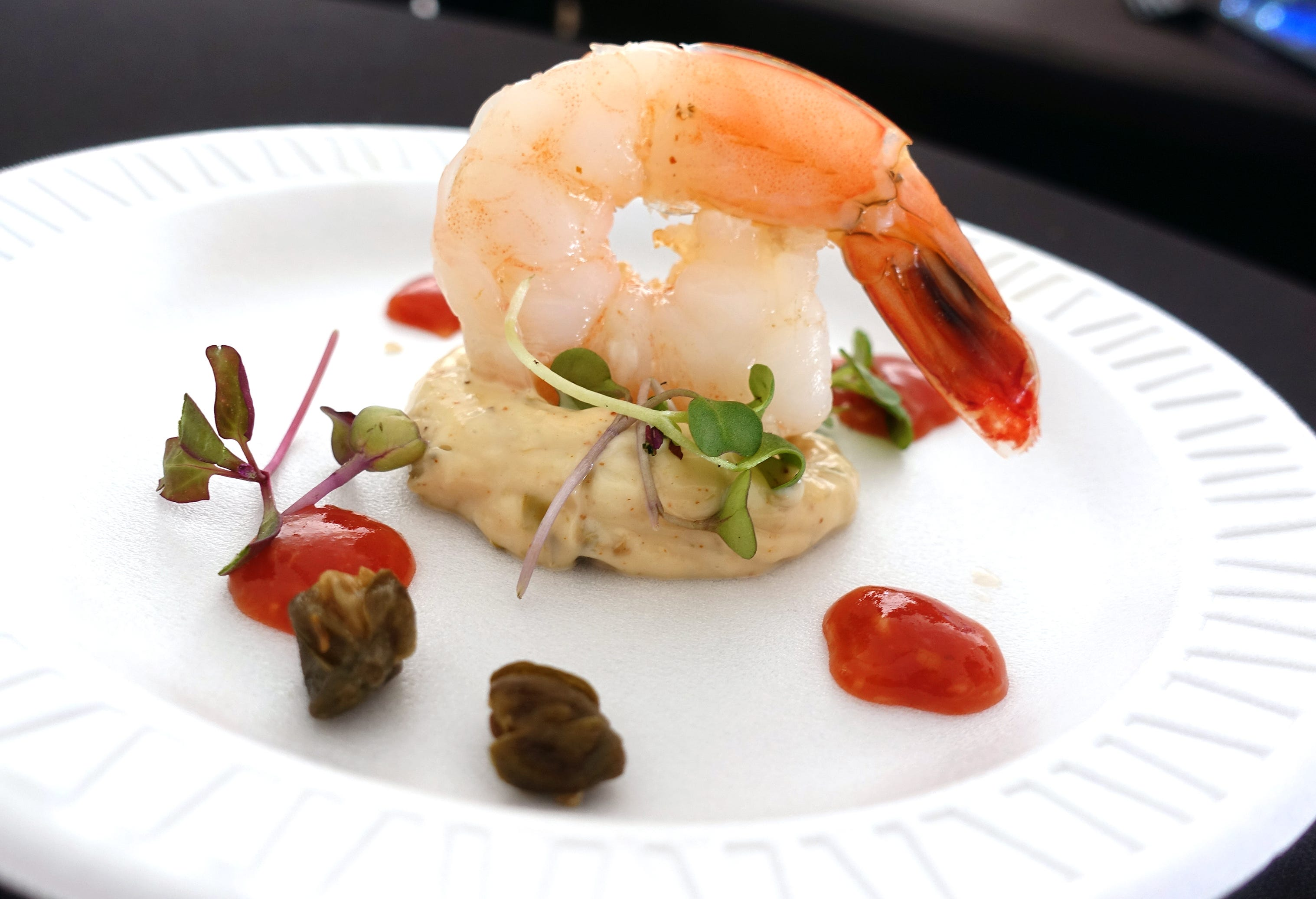 Poached shrimp with house remoulade, cocktail sauce, fried capers and microgreens from Mingo's Louisiana Kitchen at azcentral Wine & Food Experience at WestWorld of Scottsdale Saturday, Nov. 3, 2018.