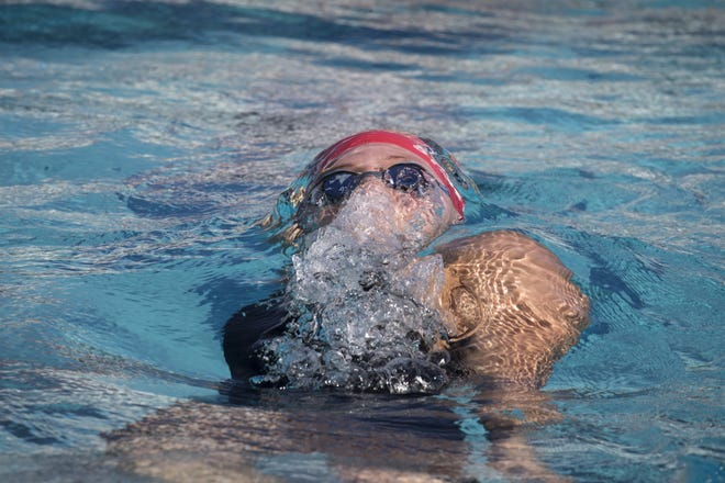 Sydney Carlson (Arcadia) swims the backstroke during the 200 IM, November 3, 2018, during the AIA Division II state swimming finals at the Skyline Aquatic Center, Mesa. Carlson won the event.