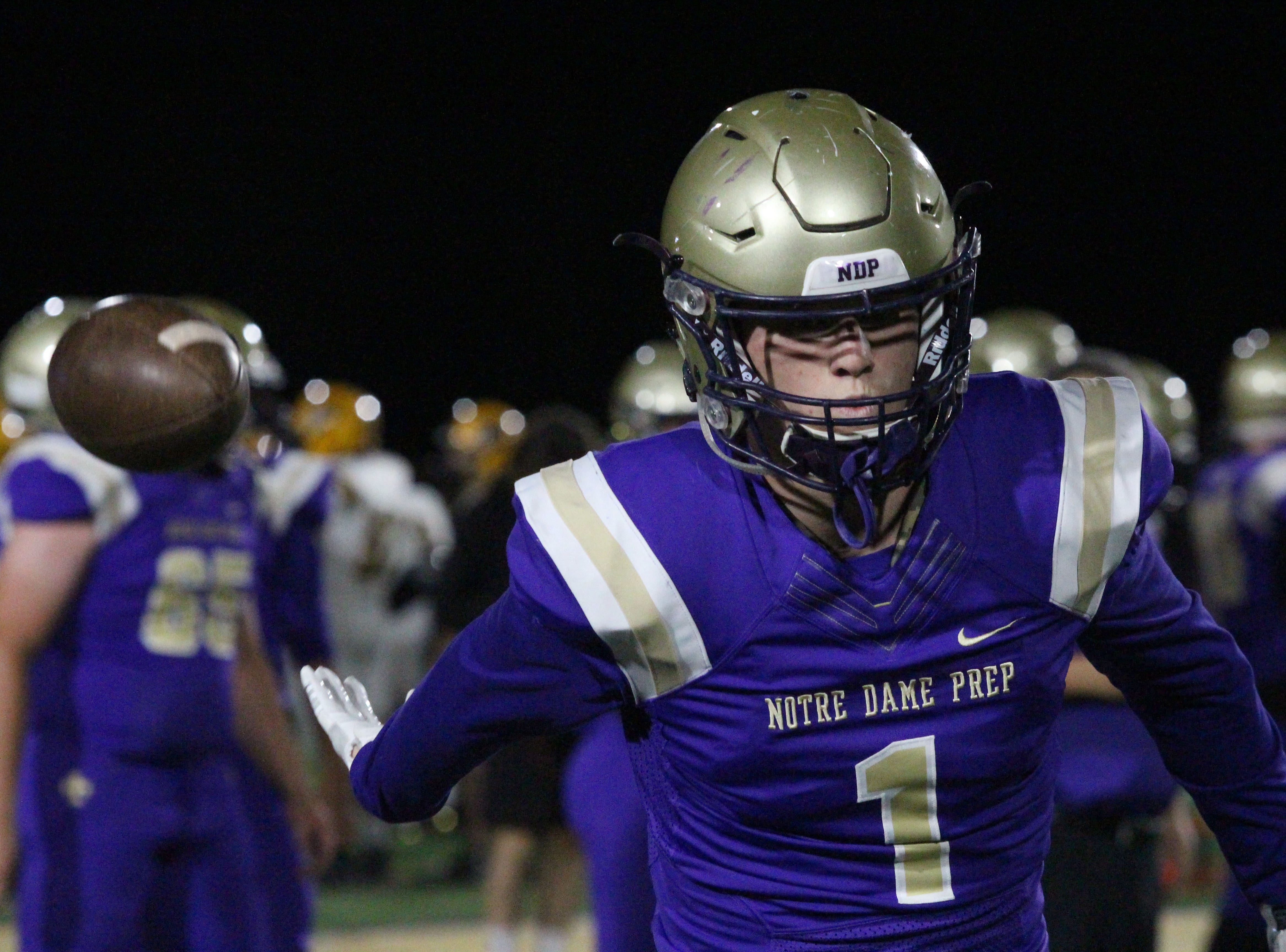 Notre Dame's Jake Smith tosses the ball behind him before the Saint's game against Gilbert on Friday night at Notre Dame Preparatory High School on Nov. 2, 2018.