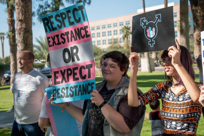 Aaron Evans and Mordecai Chavez rally at the Arizona Capitol for transgender rights, Nov. 2, 2018.