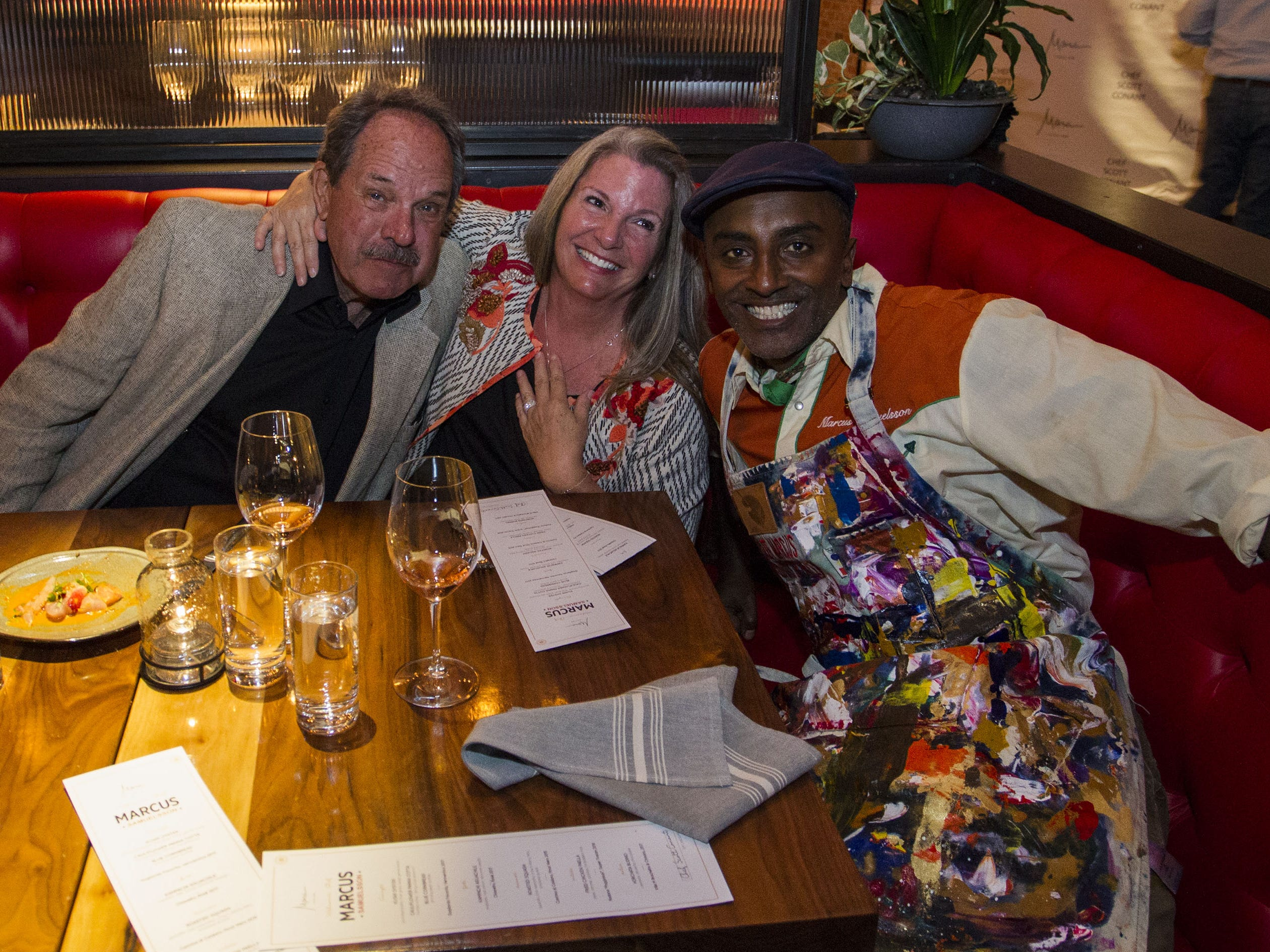 Chef Marcus Samuelsson poses with Andy and Margo Nottenkamper during the exclusive kickoff dining event at Mora Italian for azcentral Wine & Food Experience.