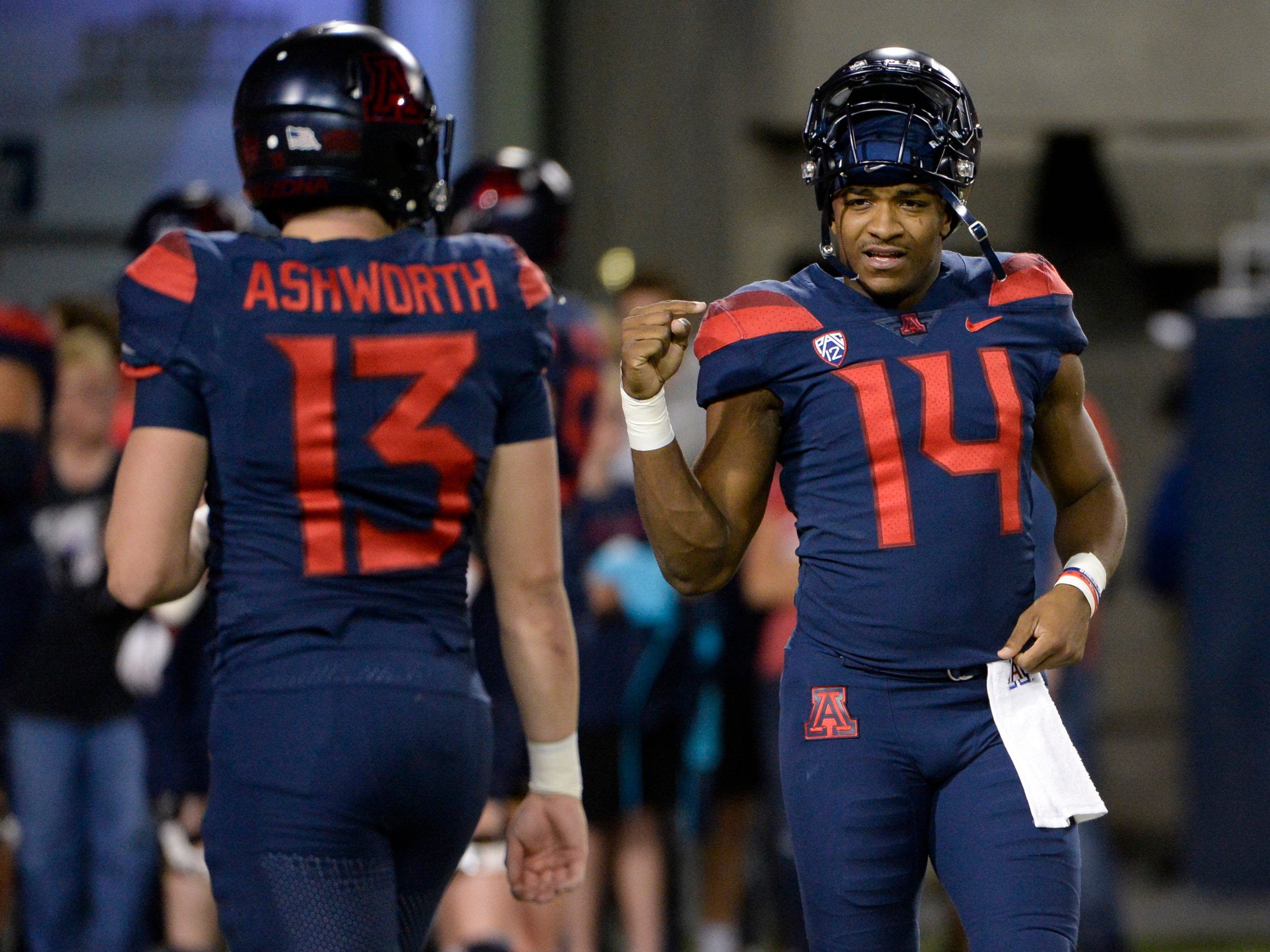Nov 2, 2018; Tucson, AZ, USA; Arizona Wildcats quarterback Khalil Tate (14) signals to quarterback Luke Ashworth (13) before playing against the Colorado Buffaloes at Arizona Stadium.