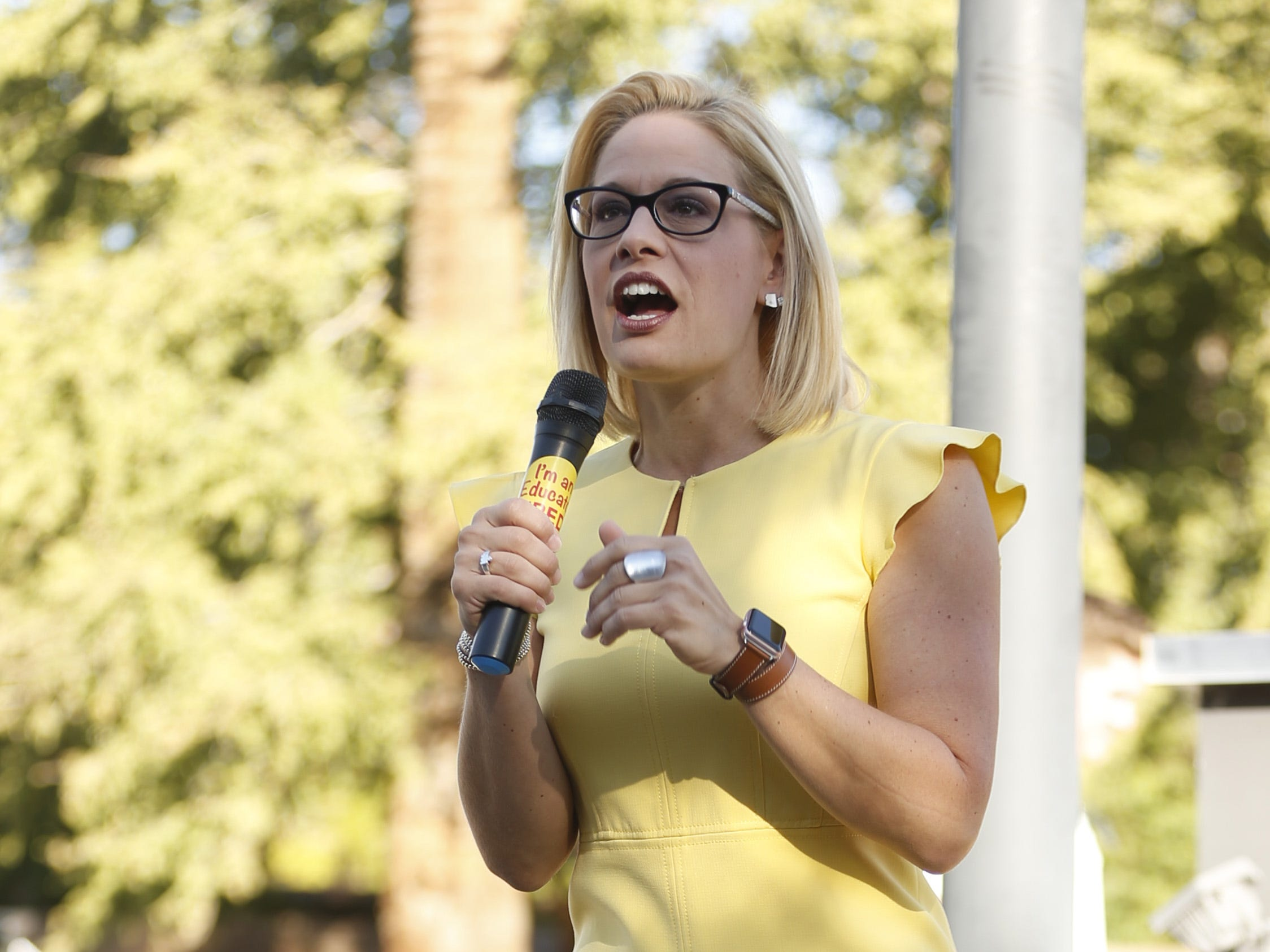 Senate candidate Kyrsten Sinema speaks during a rally outside the Arizona Education Association offices in Phoenix on November 3, 2018.