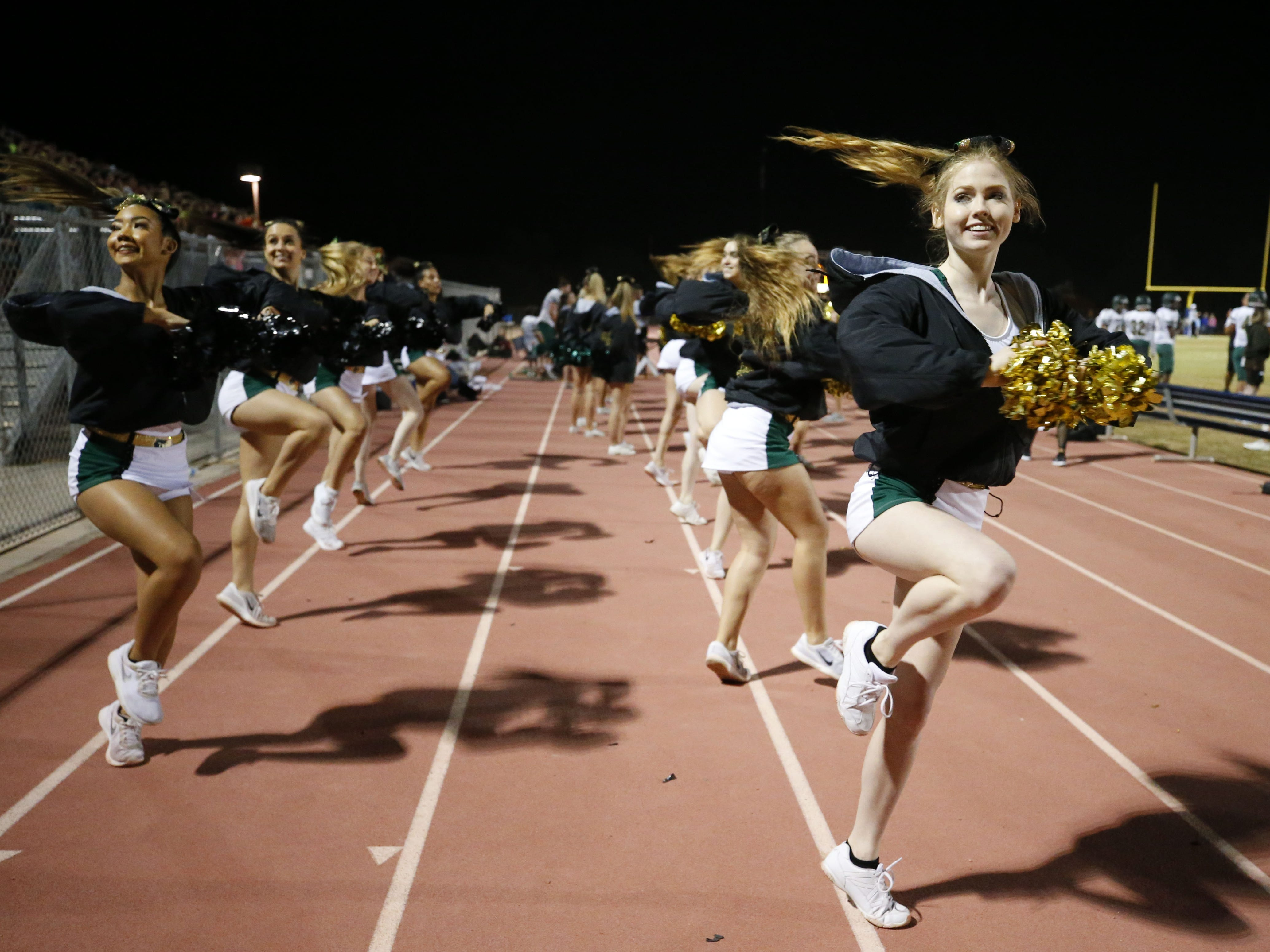 Basha cheerleaders perform during a football game against Perry at Perry High School on November 2. #azhsfb
