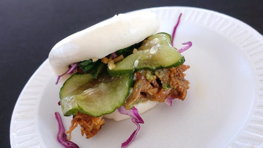 Red miso-braised jackfruit bun with purple cabbage and cilantro-lime sauce from Obon Sushi + Bar + Ramen at azcentral Wine & Food Experience 2018 at WestWorld of Scottsdale, Saturday, Nov. 3, 2018.