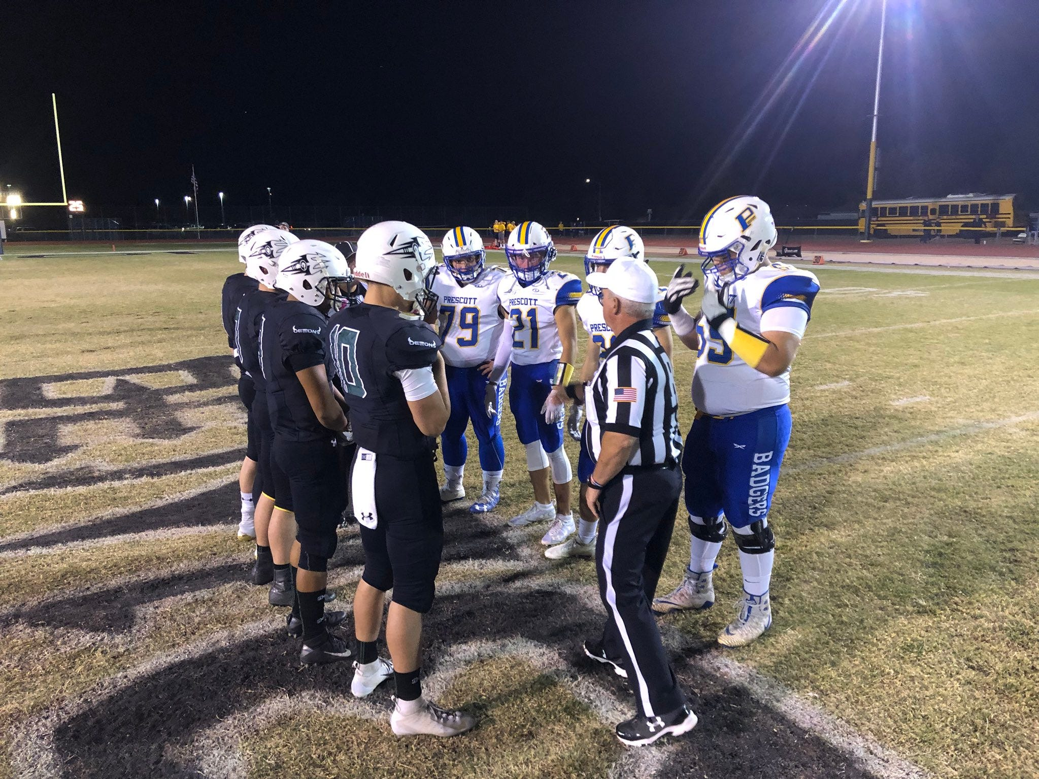 Phoenix Greenway and Prescott meet at midfield for the pregame coin toss on Friday, Nov. 2, 2018.