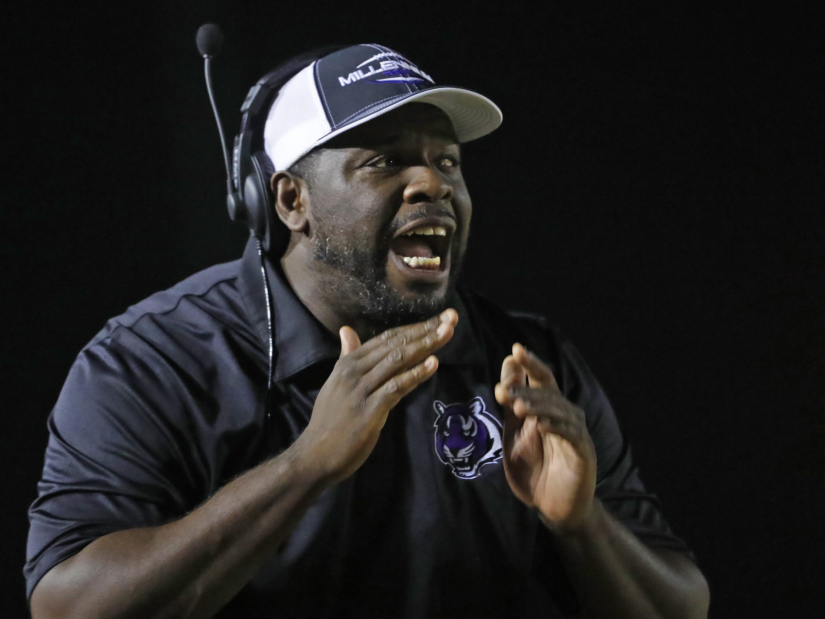 Millennium's head coach Lamar Early yells to his team during the first round of the AIA State Football Playoffs against Flowing Wells at Millennium High School in Goodyear, Ariz. on Nov. 2, 2018.