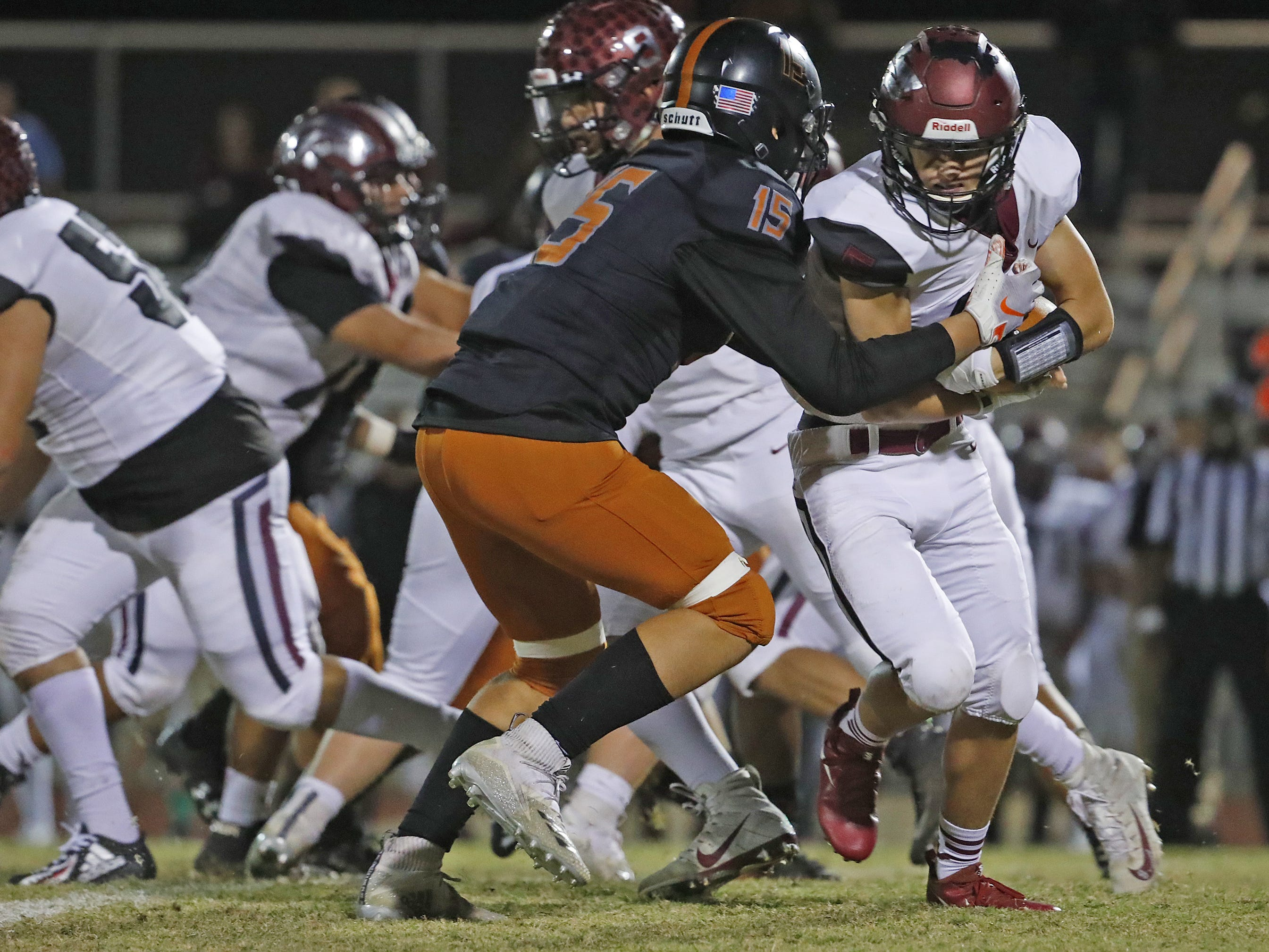 Desert Edge's Cameron Steele (15) tackles Walden Grove's William Fortin (5) during the first round of the AIA State Football Playoffs at Desert Edge High School in Goodyear, Ariz. on Nov. 2, 2018.
