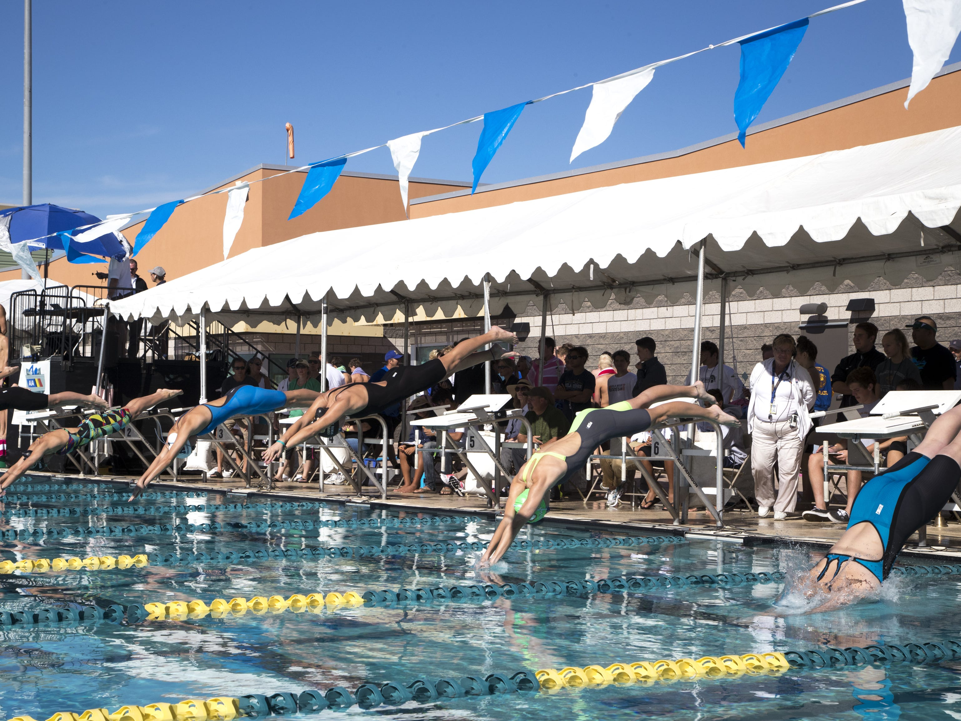 The start of Heat 1 of the 100 Freestyle, November 3, 2018, during the AIA Division II state swimming finals at the Skyline Aquatic Center, Mesa. Moore won the event.