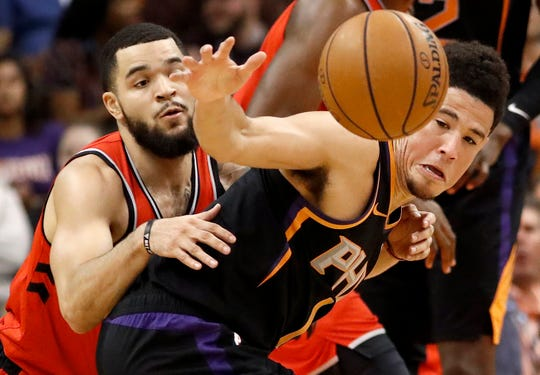 Suns guard Devin Booker and Raptors guard Fred VanVleet battle for the ball during a game on Nov. 2.
