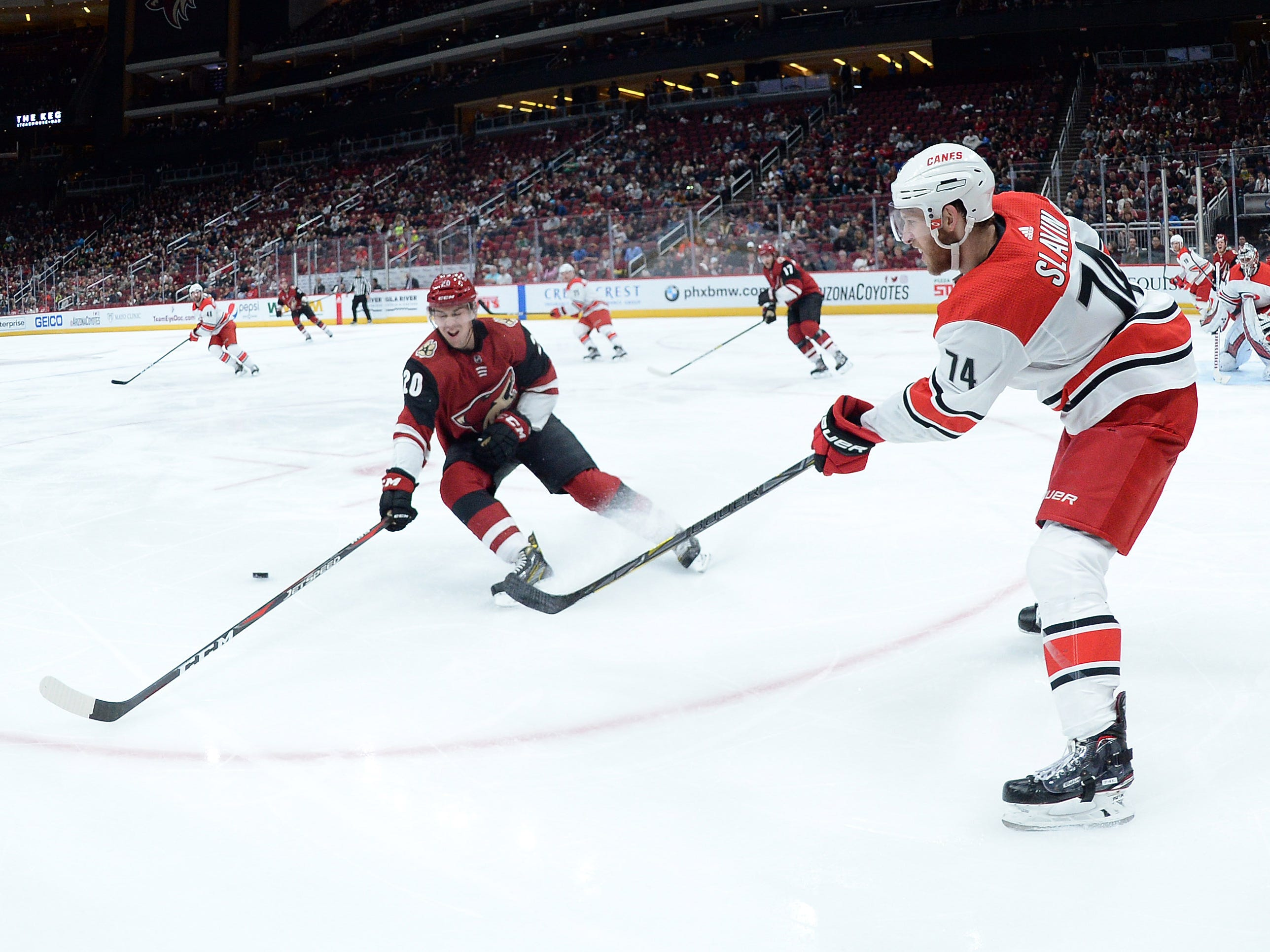 Nov 2, 2018: Carolina Hurricanes defenseman Jaccob Slavin (74) moves the puck past Arizona Coyotes center Dylan Strome (20) during the second period at Gila River Arena.