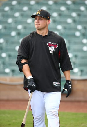 Diamondbacks-drafted minor league catcher Daulton Varsho walks the field during pregame batting practice with Salt River Rafters on Oct. 23 at Salt River Fields at Talking Stick.