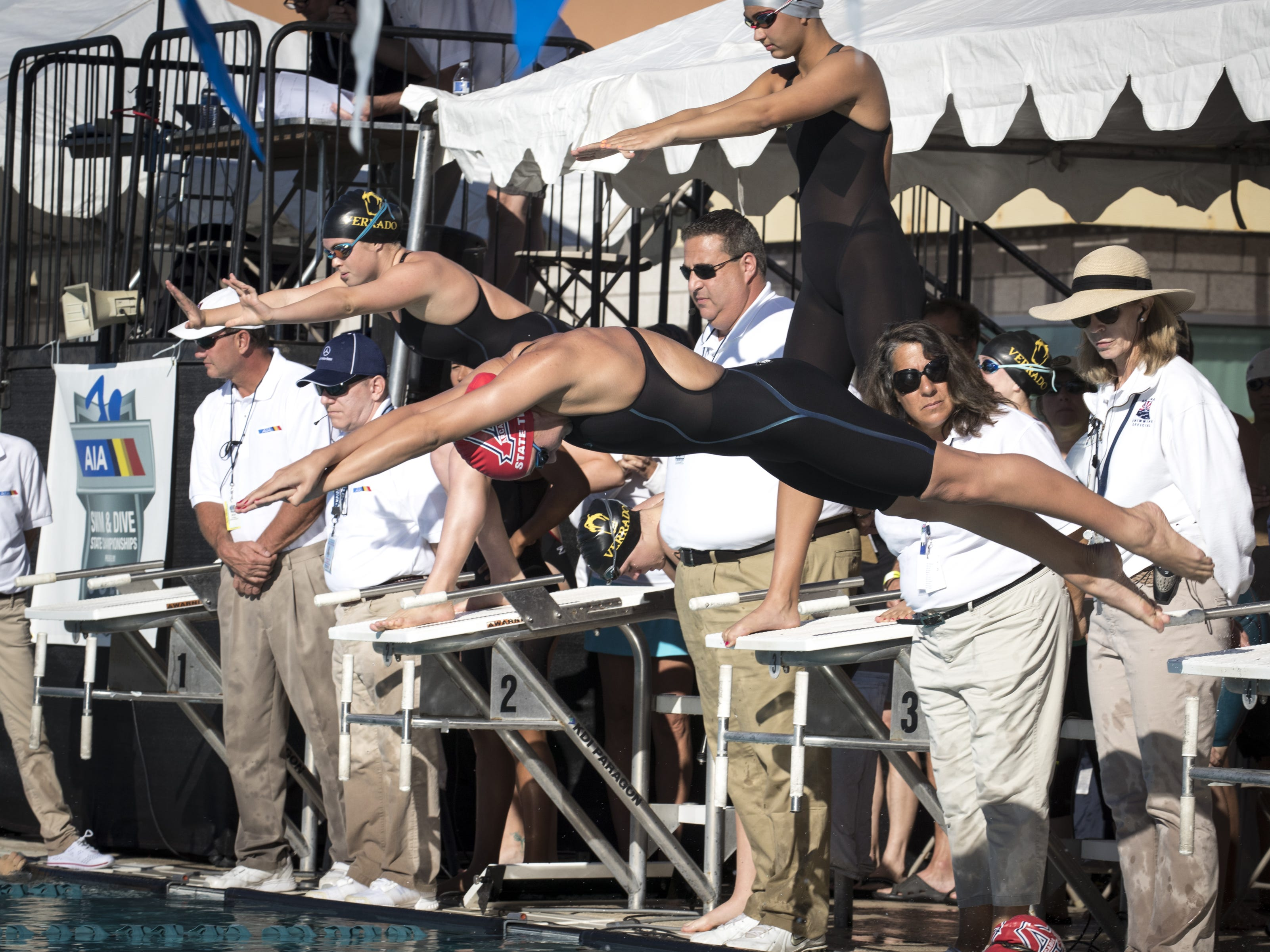 An Arcadia High School swimmer leaves the blocks during 200 Medley Relay, November 3, 2018, at the AIA Division II state swimming finals at the Skyline Aquatic Center, Mesa. Arcadia won the relay.
