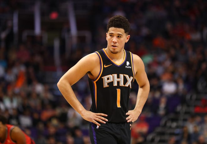 Suns guard Devin Booker reacts during the second quarter of a game against the Raptors at Talking Stick Resort Arena.
