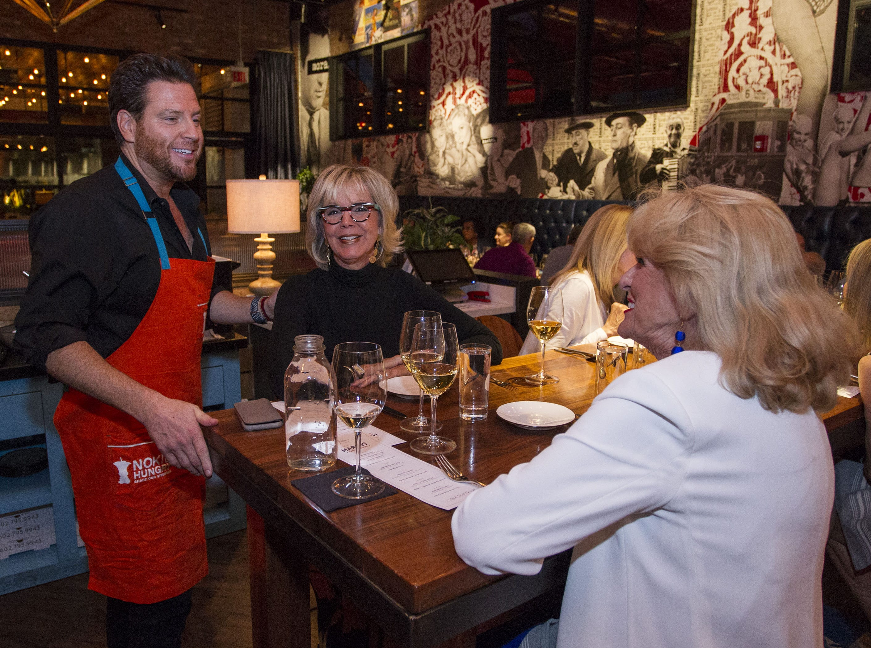 Chef Scott Conant shares a laugh with Carol Reid (middle) and Sharon Rose (right) during the exclusive kickoff dining event at Mora Italian for azcentral Wine & Food Experience.