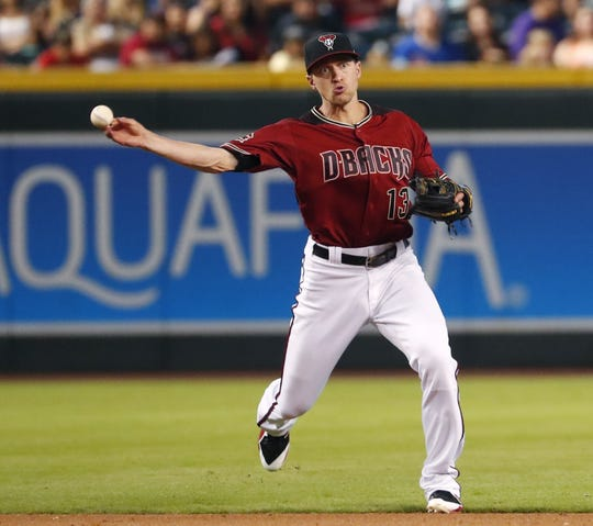 Diamondbacks shortstop Nick Ahmed throws out a Marlins baserunner at Chase Field in June.
