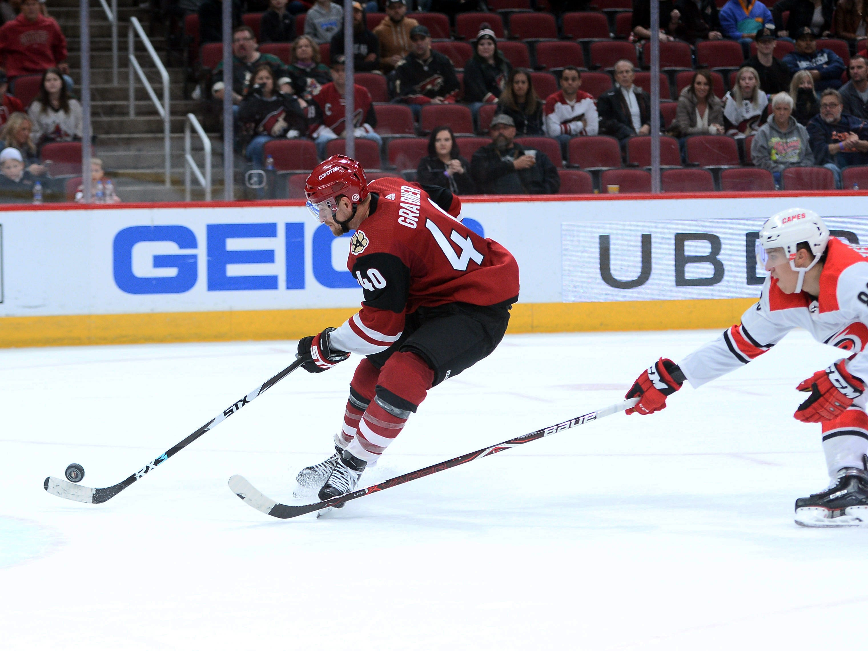 Nov 2, 2018: Arizona Coyotes right wing Michael Grabner (40) shoots and scores the game winning goal in front of Carolina Hurricanes left wing Teuvo Teravainen (86) during the overtime period at Gila River Arena.