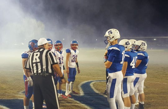Valley Christian and Coolidge meet at midfield for the pregame coin toss on Nov. 2, 2018.