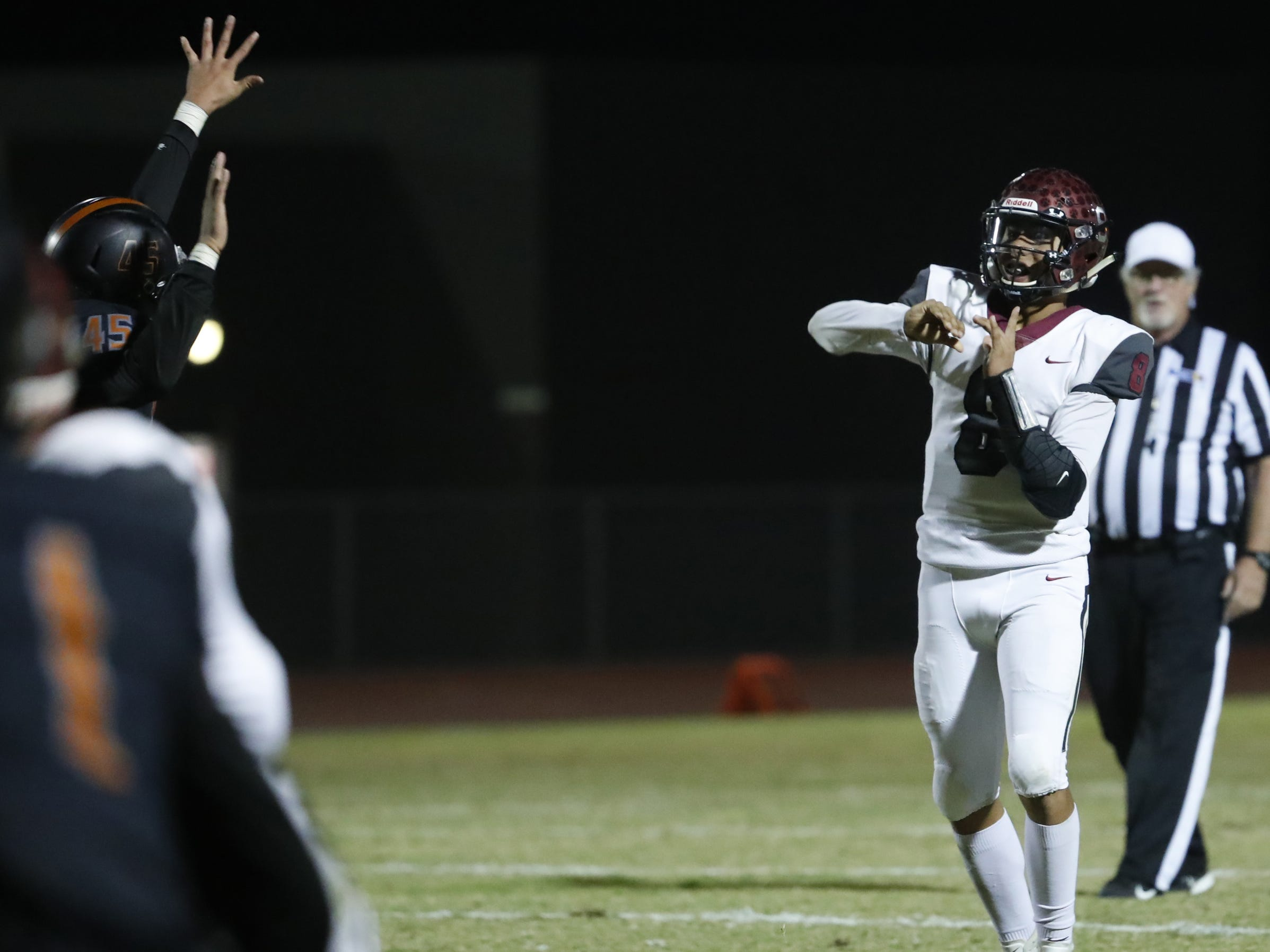 Walden Grove's Alex Lopez (8) throws a screen pass against Desert Edge during the first round of the AIA State Football Playoffs at Desert Edge High School in Goodyear, Ariz. on Nov. 2, 2018.