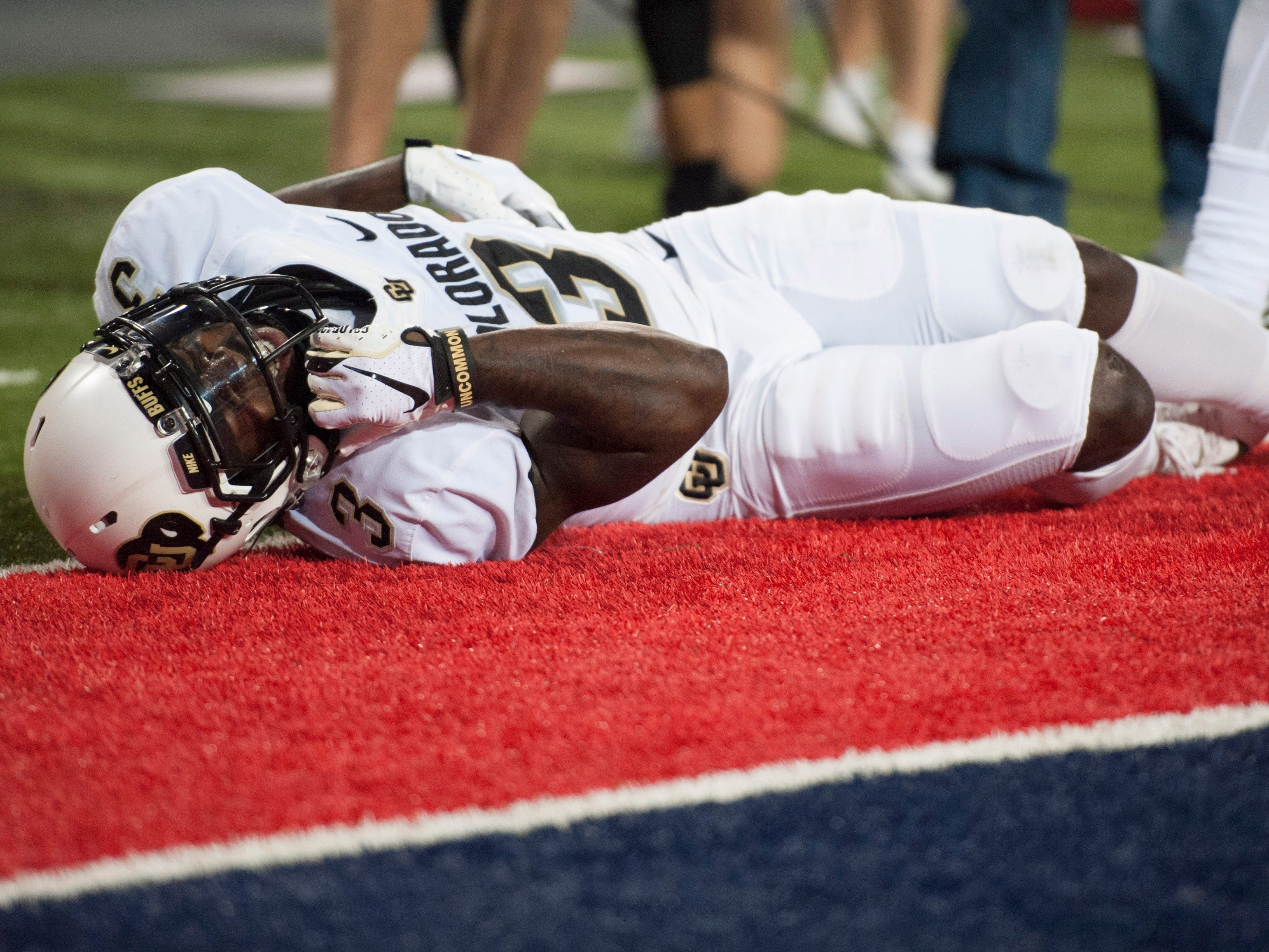 Nov 2, 2018; Tucson, AZ, USA; Colorado Buffaloes wide receiver K.D. Nixon (3) lays on the field after scoring a touchdown against the Arizona Wildcats during the first half at Arizona Stadium.