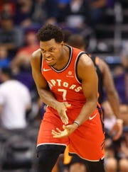 Raptors guard Kyle Lowry celebrates after making a shot against the Suns during a game at Talking Stick Resort Arena.