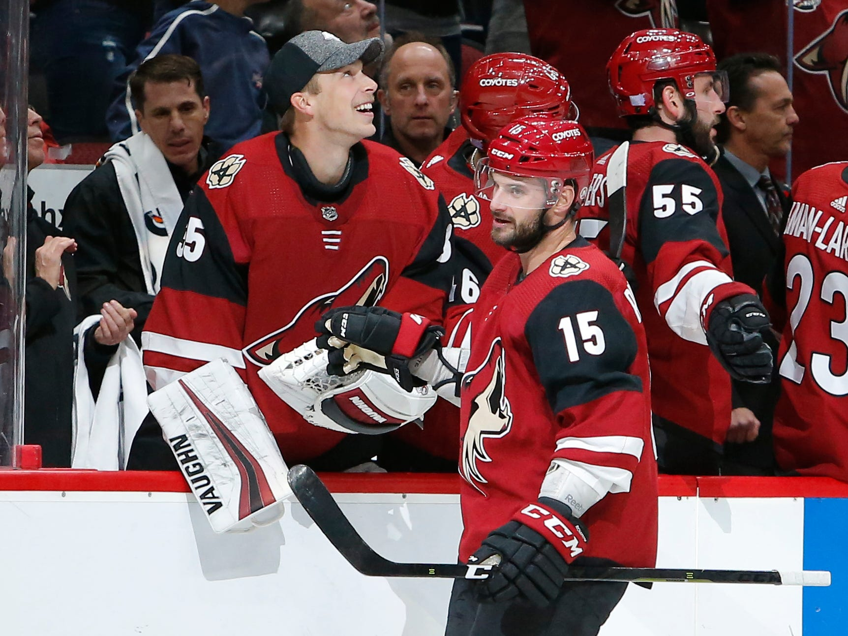 Arizona Coyotes center Brad Richardson (15) celebrates with teammates after scoring a goal against the Carolina Hurricanes during the first period of an NHL hockey game Friday, Nov. 2, 2018, in Glendale, Ariz. (AP Photo/Rick Scuteri)