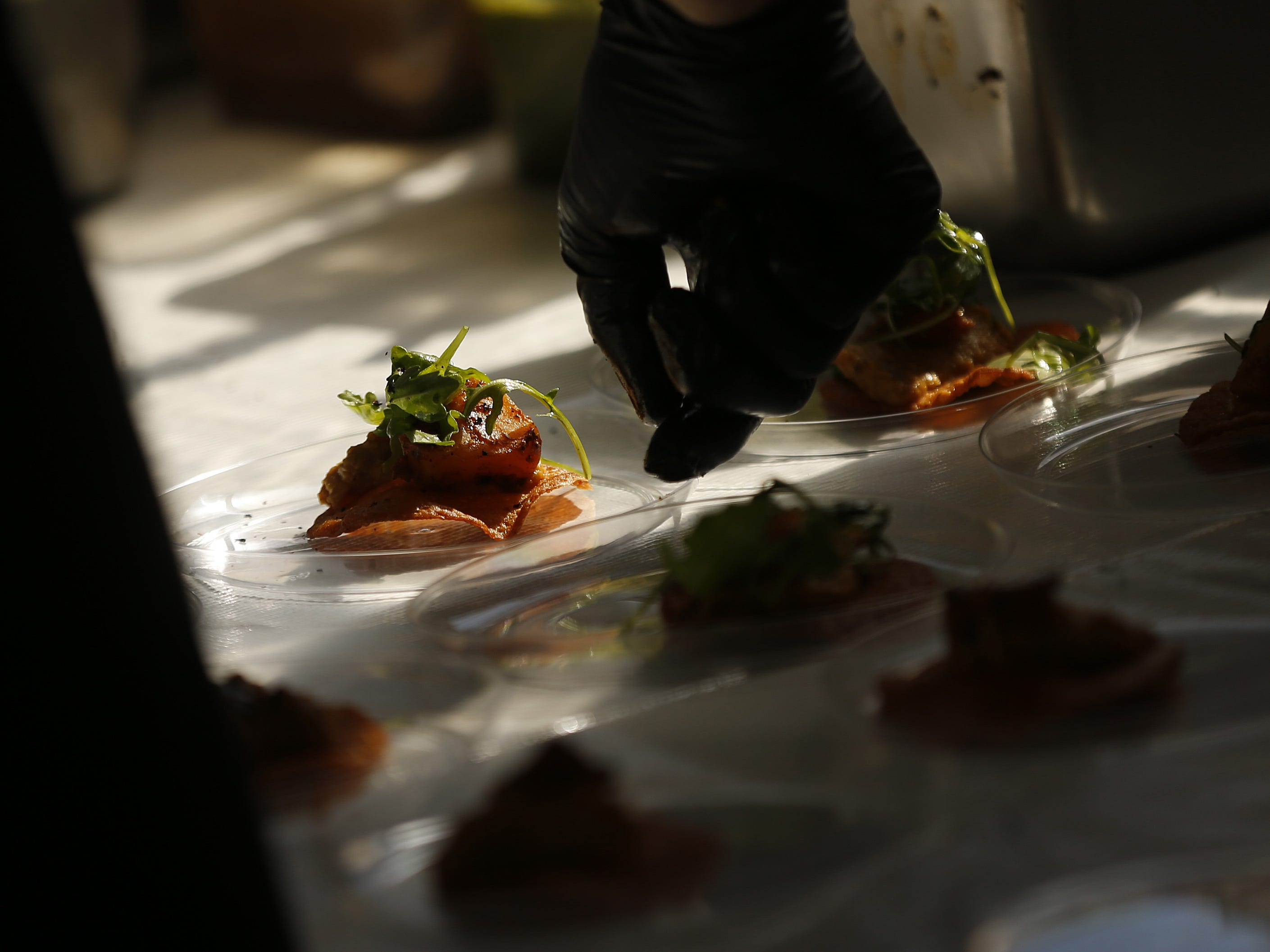Crepe Bar chefs prepare crepe-tats with Hatch chiles and barbecue acorn squash during the azcentral Wine & Food Experience at WestWorld of Scottsdale on Nov. 3, 2018.