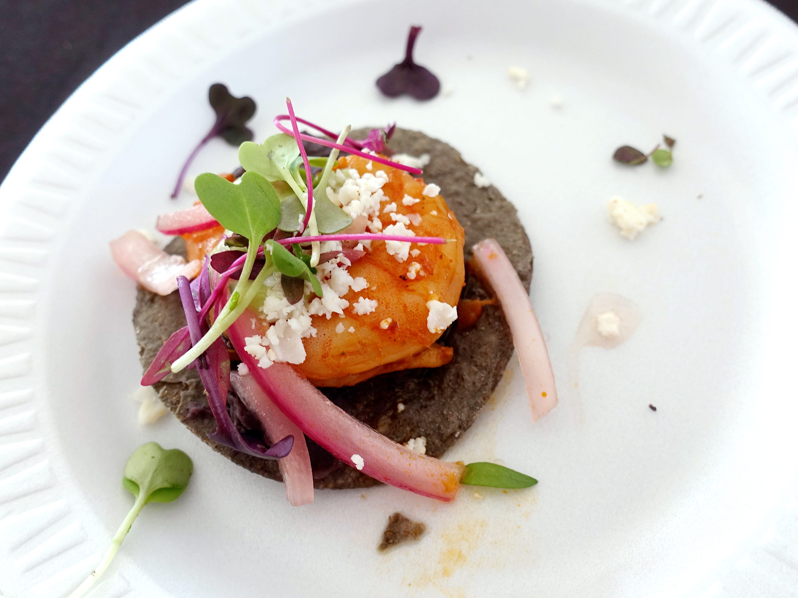 Stone ground blue corn adobo shrimp tostada with refried black beans, avocado crema and pickled red onion from Barrio Queen at azcentral Wine & Food Experience 2018 at WestWorld of Scottsdale, Saturday, Nov. 3, 2018.