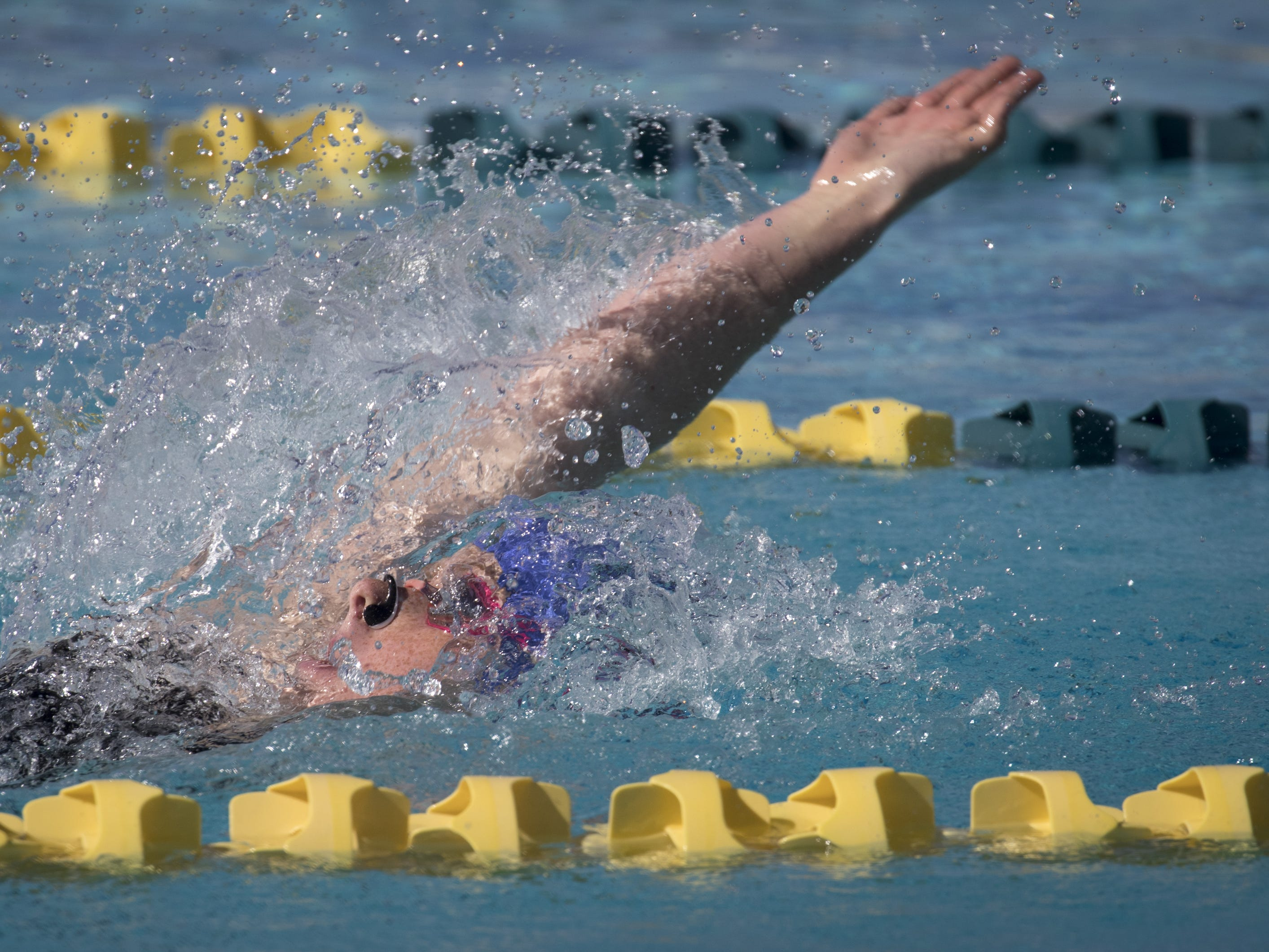 Helen Noble (Millennium) swims the 100 Backstroke, November 3, 2018, during the AIA Division II state swimming finals at the Skyline Aquatic Center, Mesa. Noble won the event.