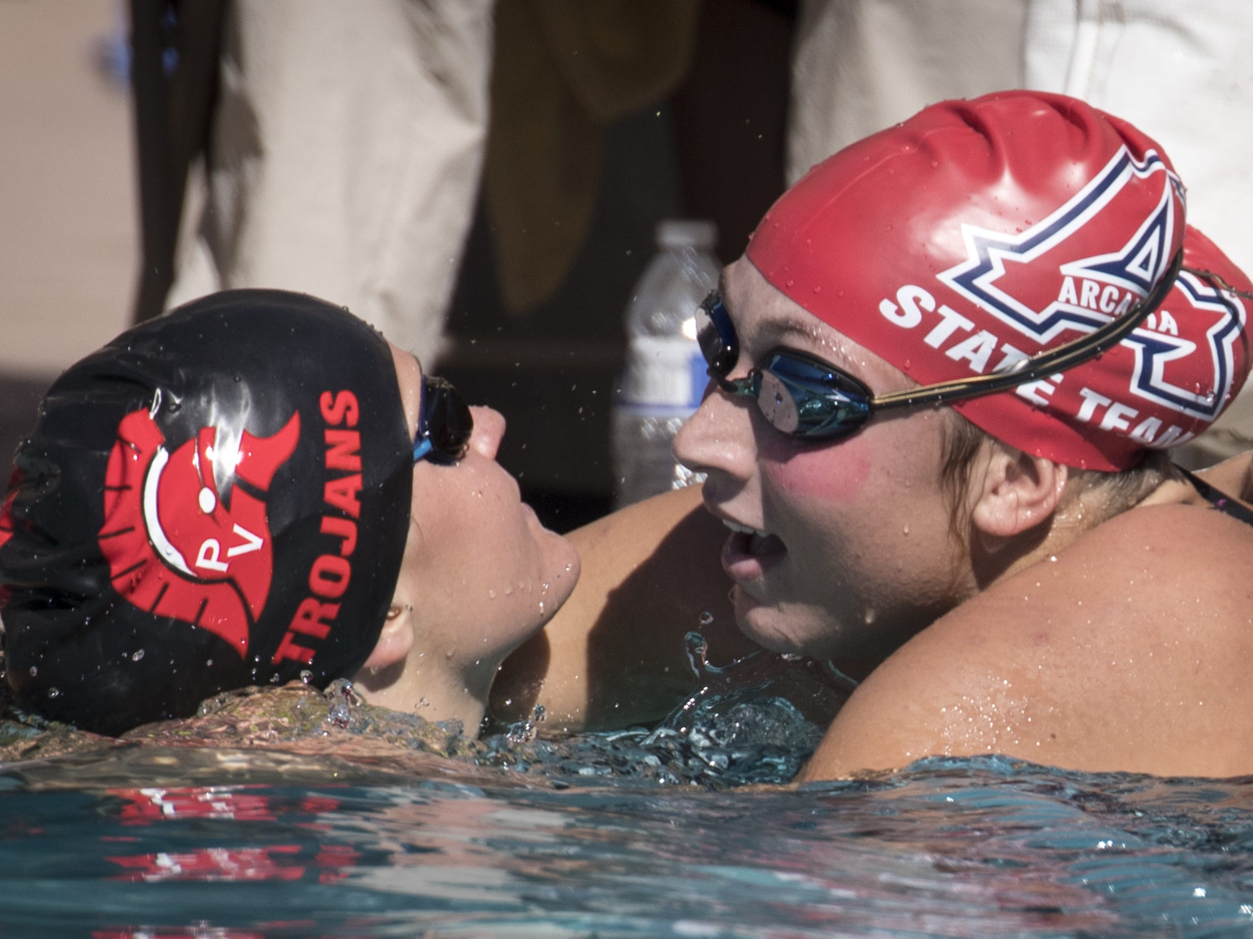 Sadie Edwards (Arcadia, left) congratulates Isabella Fratesi (Arcidia) after the 100 Breaststroke, November 3, 2018, during the AIA Division II state swimming finals at the Skyline Aquatic Center, Mesa. Fratesi won and Edwards finished second.