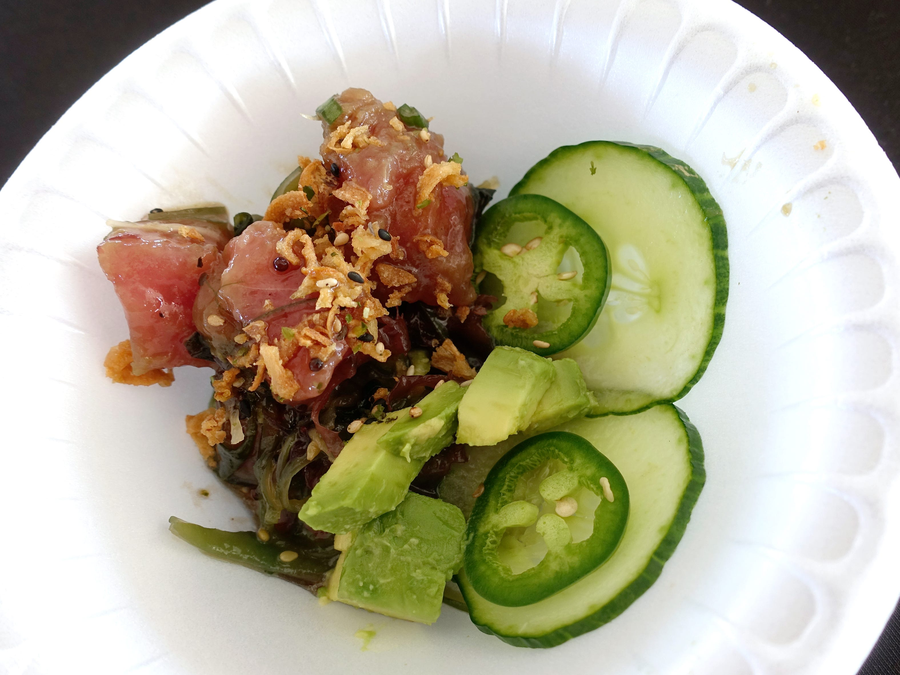 Tuna Poke with seaweed salad, citrus-soy vinaigrette, sesame oil, fried onion, scallion, jalapeno, avocado and micro cilantro from Obon Sushi + Bar + Ramen at azcentral Wine & Food Experience 2018 at WestWorld of Scottsdale, Saturday, Nov. 3, 2018.