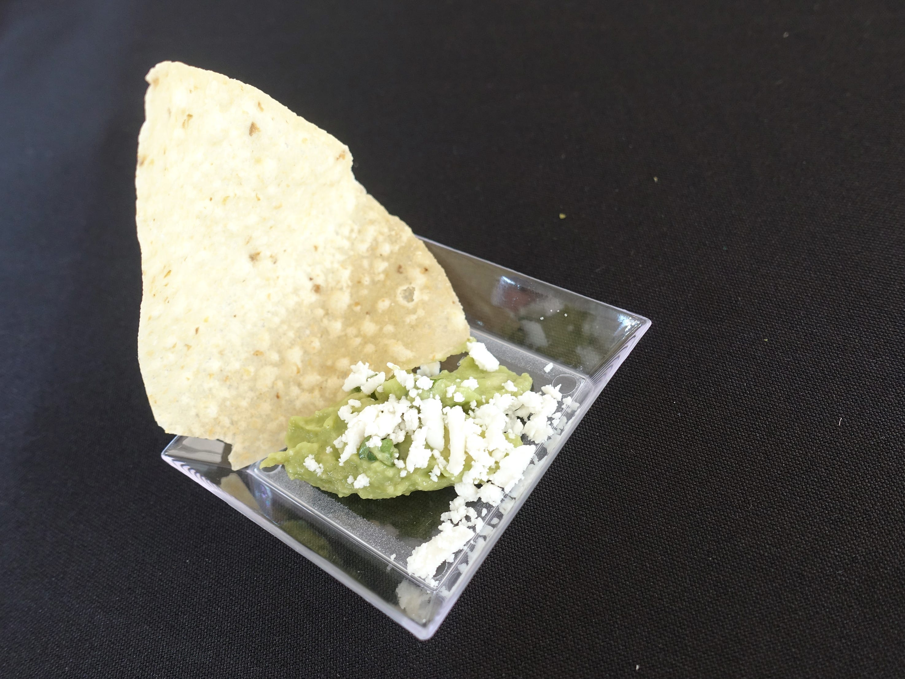 Signature guacamole with tortilla chip from Los Sombreros at azcentral Wine & Food Experience at WestWorld of Scottsdale Saturday, Nov. 3, 2018.