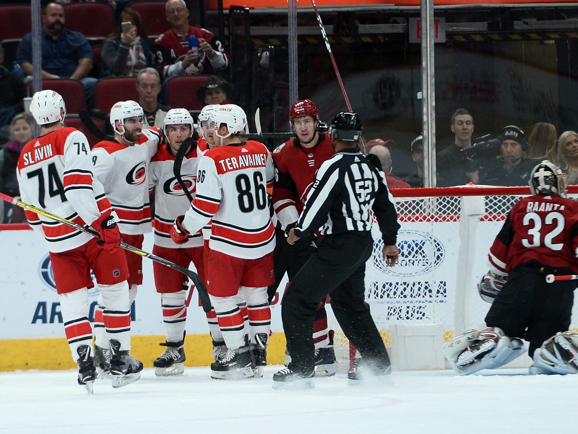 Nov 2, 2018: Carolina Hurricanes left wing Jordan Martinook (48) celebrates after scoring a goal against the Arizona Coyotes during the second period at Gila River Arena.