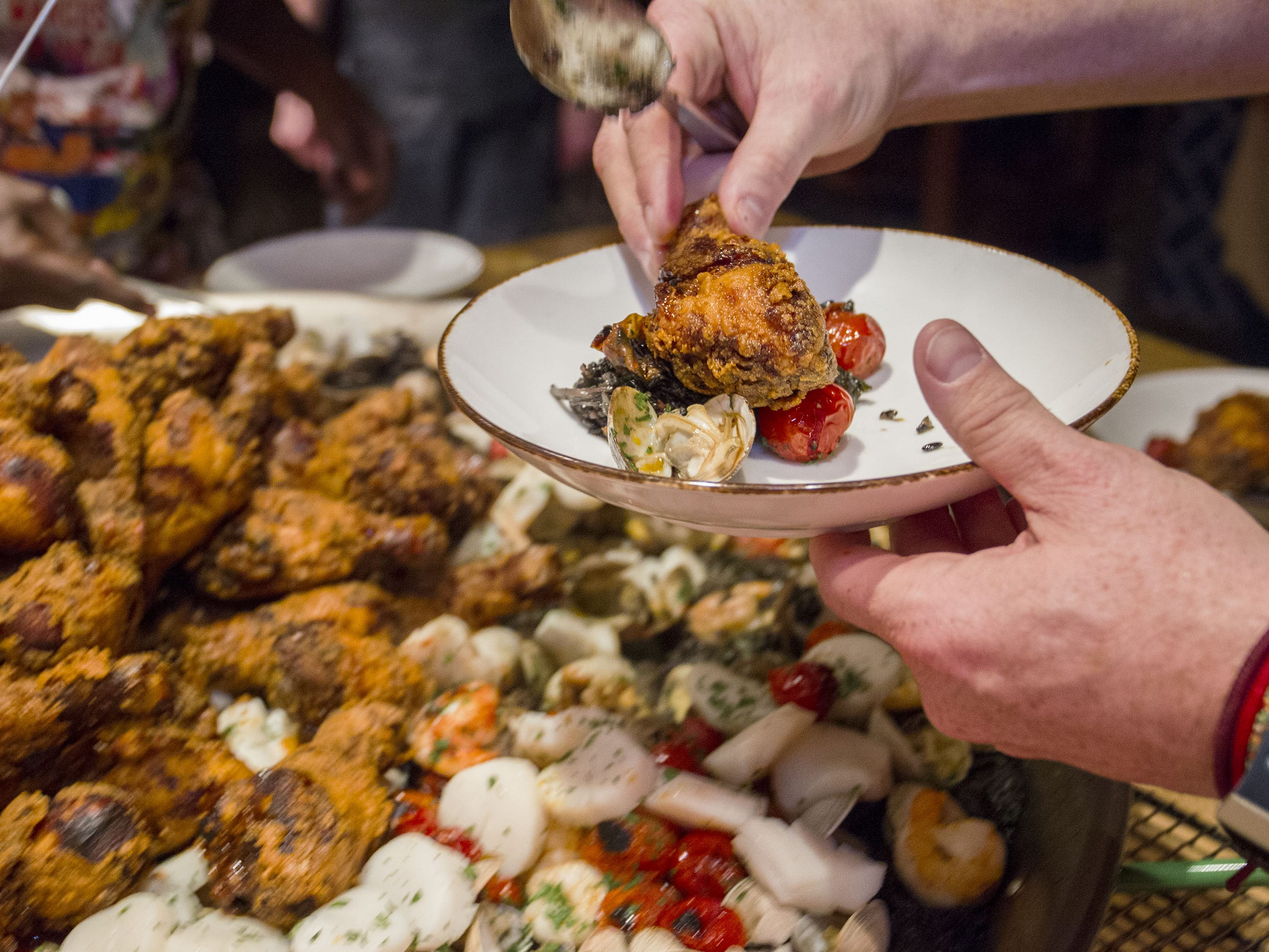 Fried chicken paella was served as the main entree to dinner guests during the exclusive kickoff dining event at Mora Italian for azcentral Wine & Food Experience.