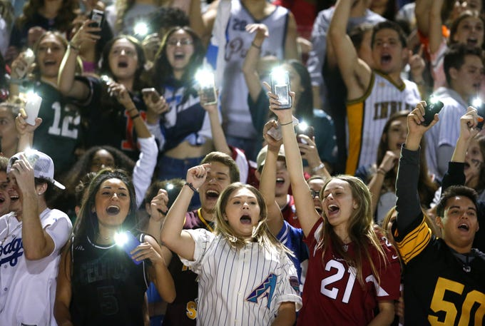 Perry fans cheer during a football game against Basha at Perry High School on November 2. #azhsfb