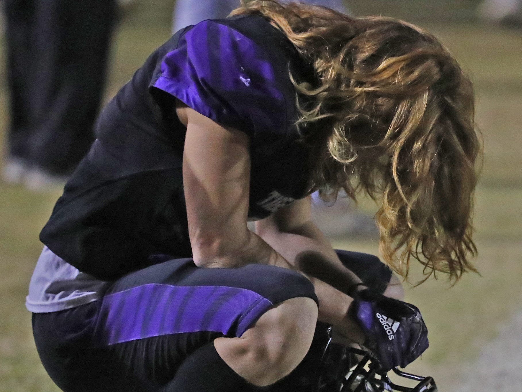 Millennium's Kyle St. Pierre (9) prays before the first round of the AIA State Football Playoffs against Flowing Wells at Millennium High School in Goodyear, Ariz. on Nov. 2, 2018.