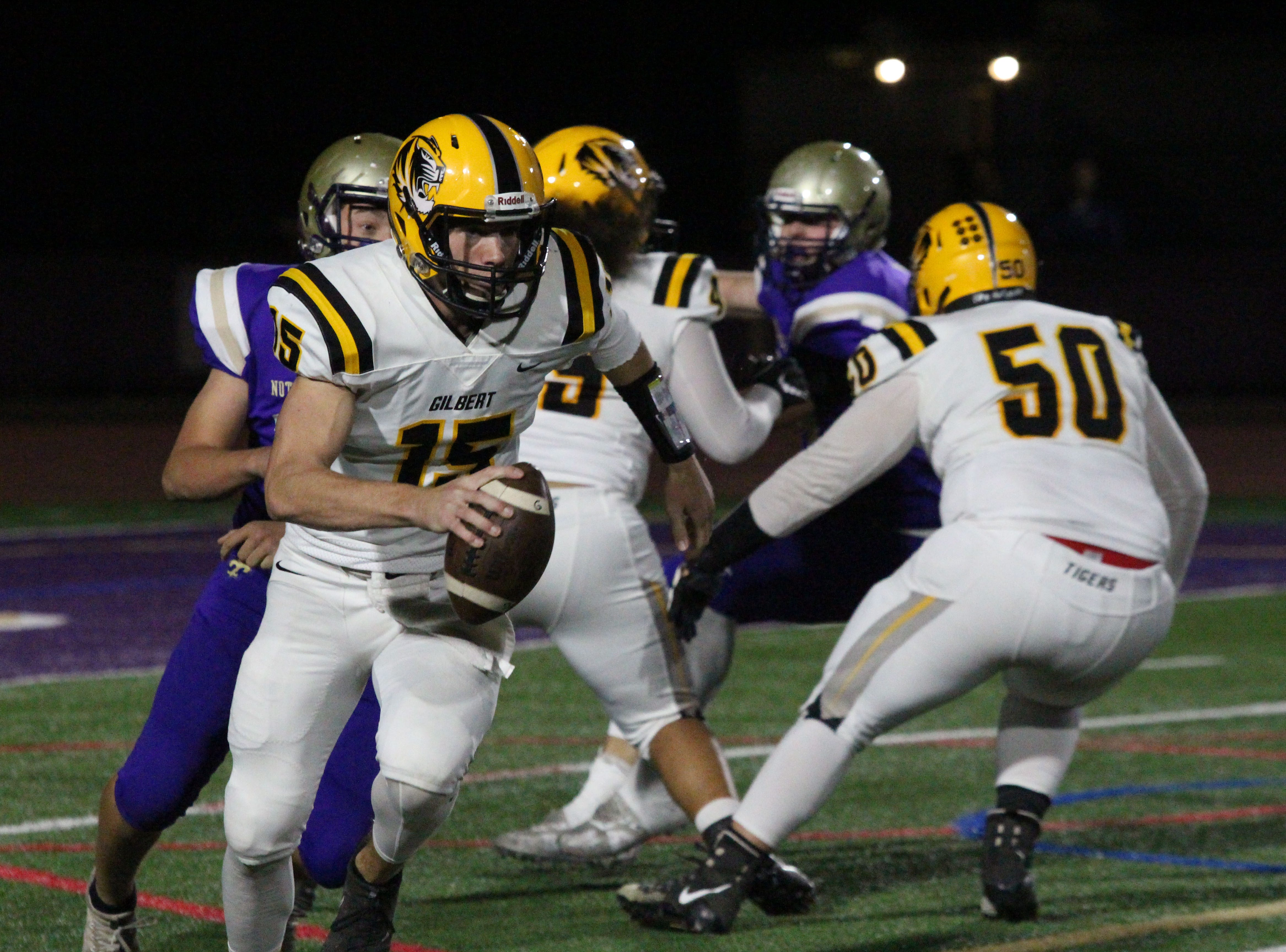Gilbert's Will Plummer escapes the Notre Dame rush on Friday night at Notre Dame Preparatory High School on Nov. 2, 2018.