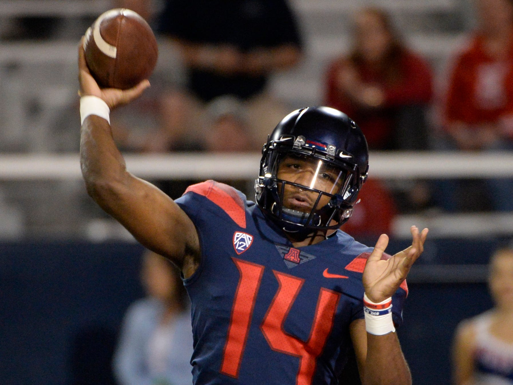 Nov 2, 2018; Tucson, AZ, USA; Arizona Wildcats quarterback Khalil Tate (14) passes the ball against the Colorado Buffaloes during the first half at Arizona Stadium.