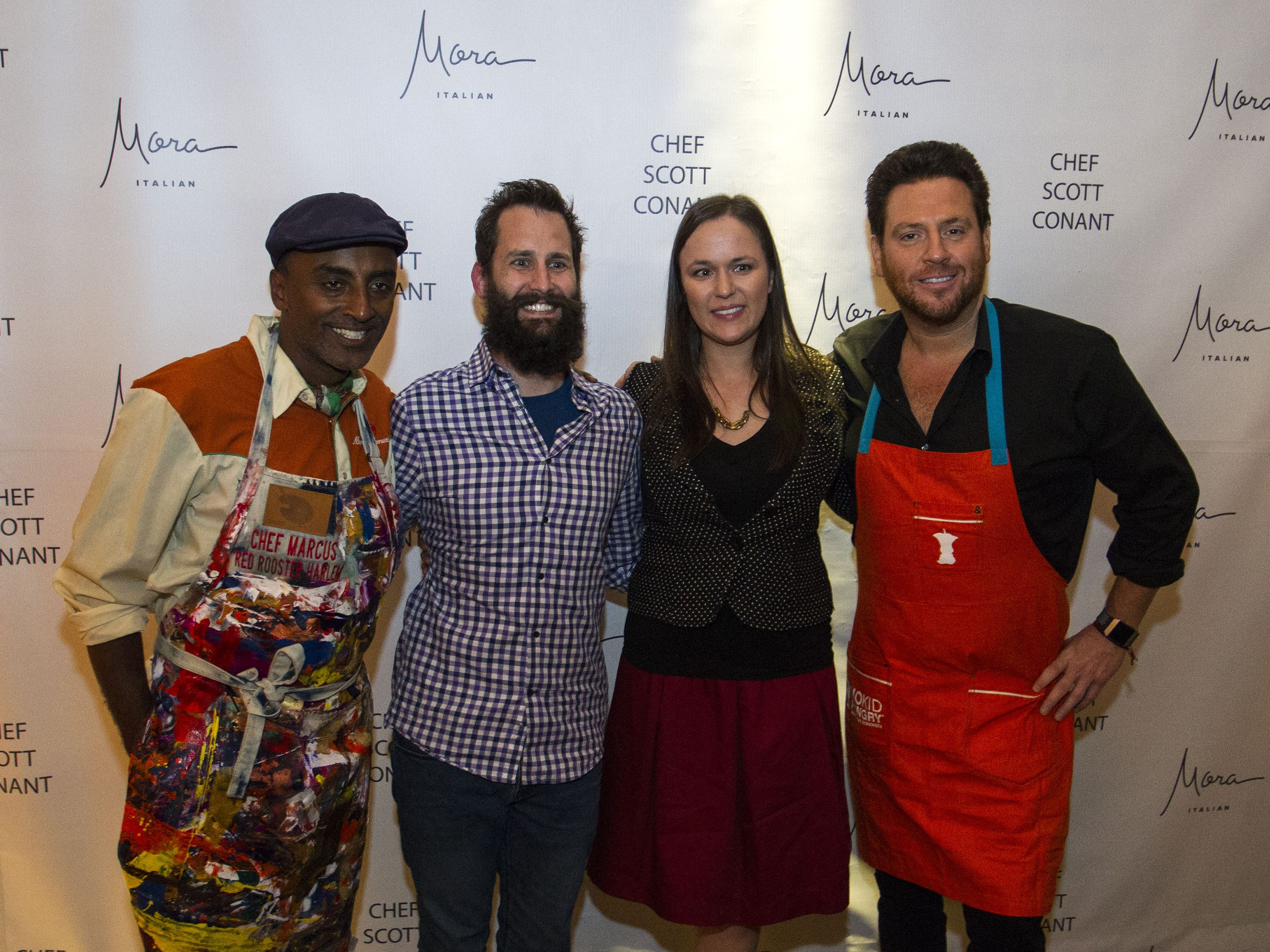 Chefs Marcus Samuelsson and Scott Conant pose with Justin and Kim Lavalette during the exclusive kickoff dining event at Mora Italian for azcentral Wine & Food Experience.