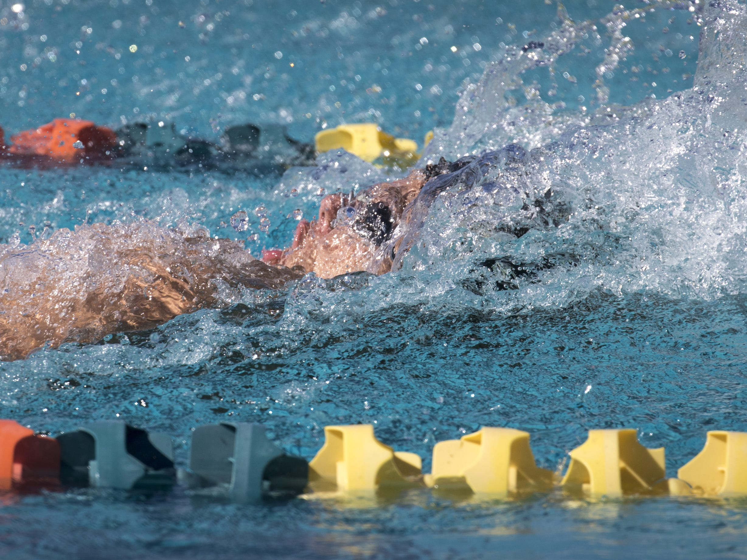 Jadan Nabor (Verrado) swims the 100 Backstroke, November 3, 2018, during the AIA Division II state swimming finals at the Skyline Aquatic Center, Mesa. Nabor won the event.