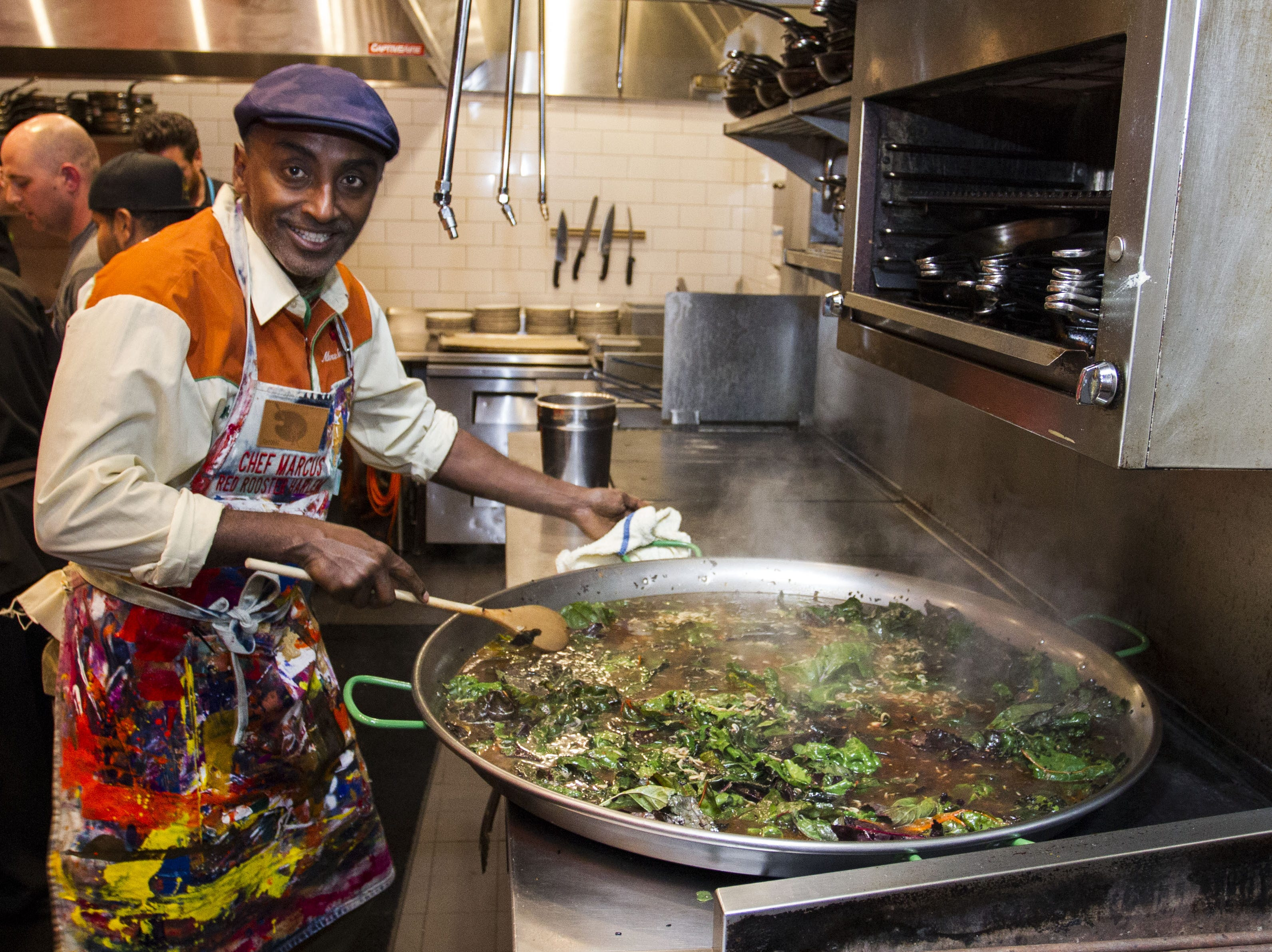 Chef Marcus Samuelsson prepares paella during the exclusive kickoff dining event at Mora Italian for azcentral Wine & Food Experience.