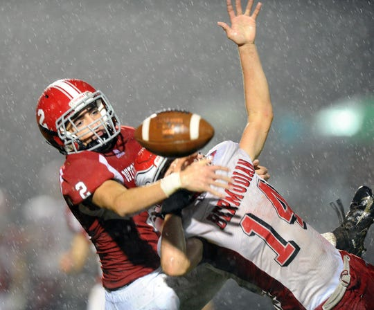 A-C's Hayden Funck (2) breaks up this 3rd down pass intended for Bermudian Springs' Tyler Sims (14).