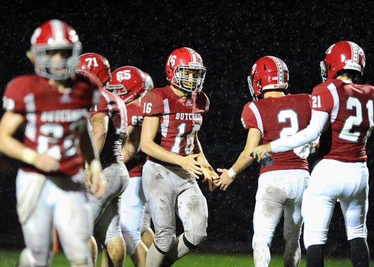 A-C QB Jeremy Bours (16) is congratulated by his teammates after scoring a touchdown to tie the game 7-7.