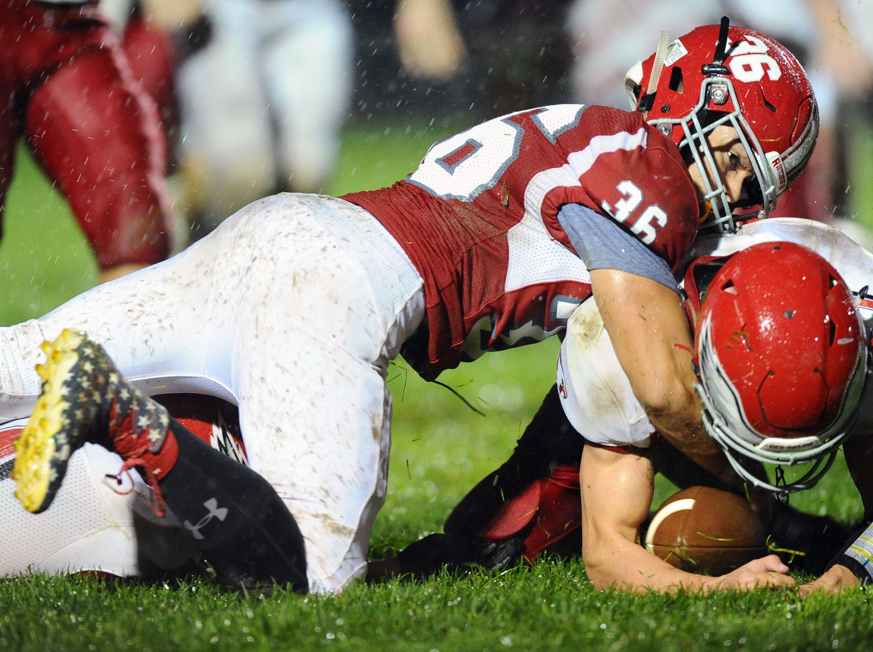 A-C's Romeo Varela (36) loses this first half fumble on the 9 yard- line to Bermudian Springs Ryan Hart (21)  in a District III 3A playoff game Friday Nov.2,2018 at Annville-Cleona High School.